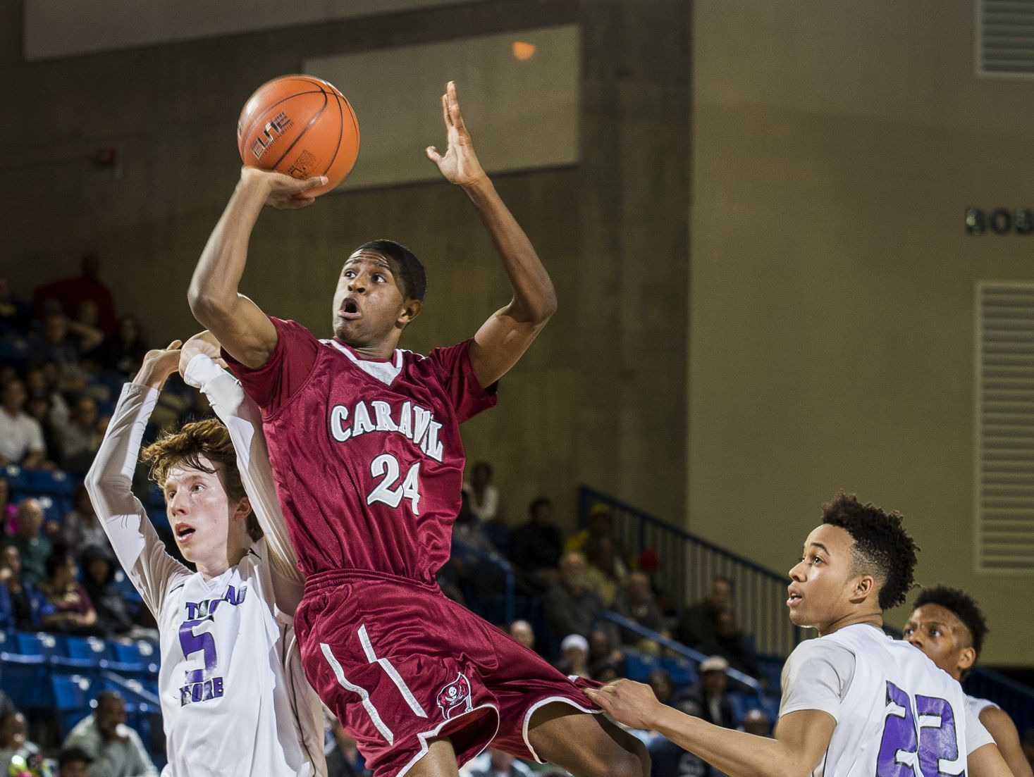 Caravel's O'Koye Parker puts up a shot in the first half of Caravel Academy's 48-47 win over St. Thomas More Academy in the DIAA Boy's State Basketball Tournament semi-finals at the Bob Carpenter Center in Newark on Thursday evening.