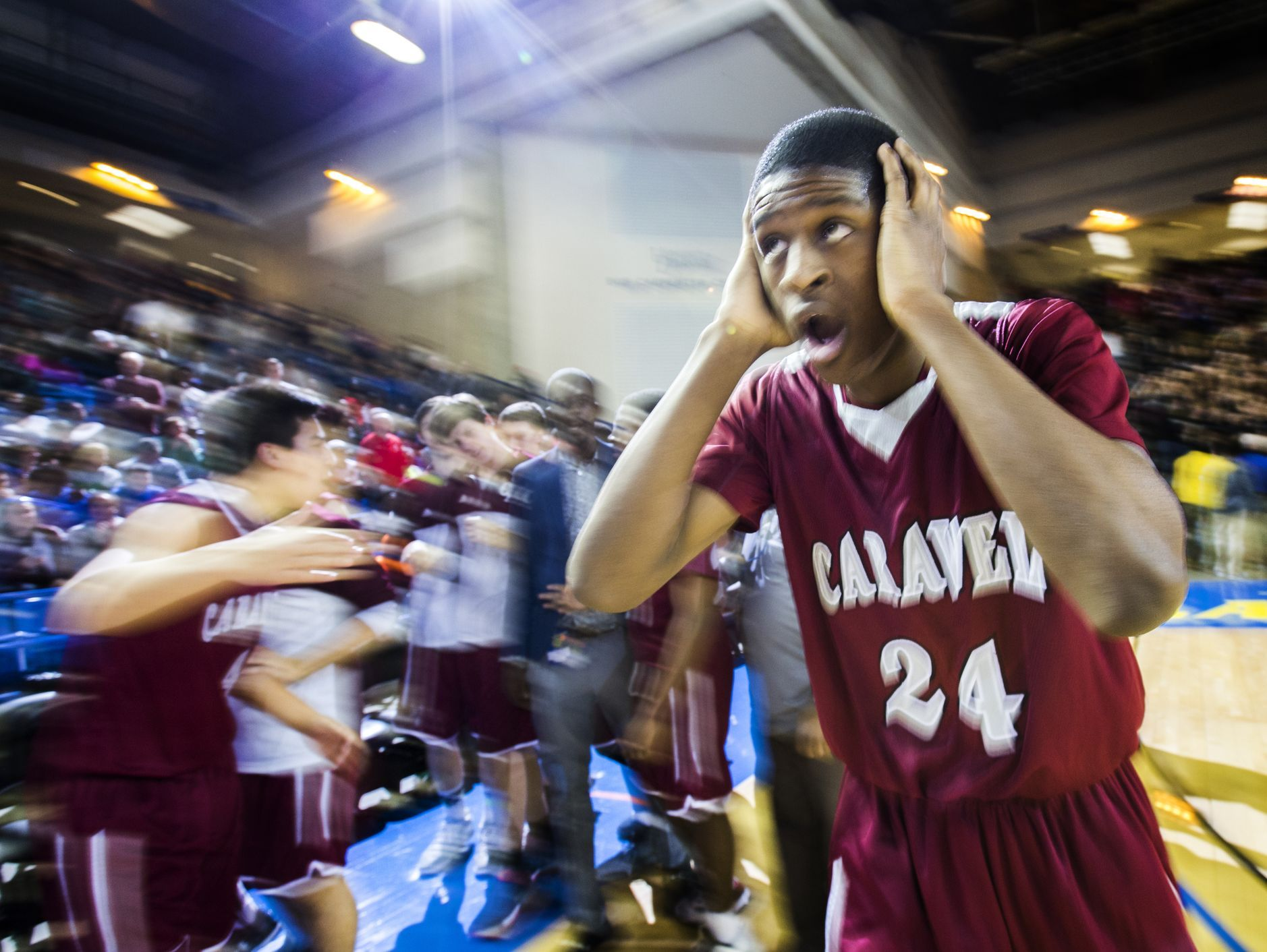 O'Koye Parker reacts as his teammates celebrate following their 48-47 win over St. Thomas More Academy in the DIAA Boy's State Basketball Tournament semi-finals at the Bob Carpenter Center in Newark on Thursday evening.