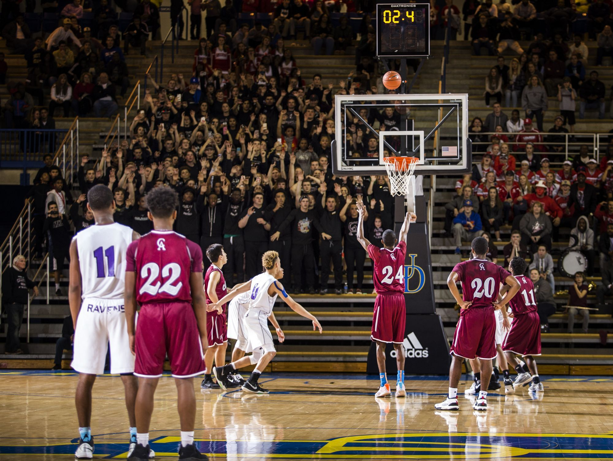 Caravel's O'Koye Parker hits the game-winning free throw in the second half of Caravel Academy's 48-47 win over St. Thomas More Academy in the DIAA Boy's State Basketball Tournament semi-finals at the Bob Carpenter Center in Newark on Thursday evening.
