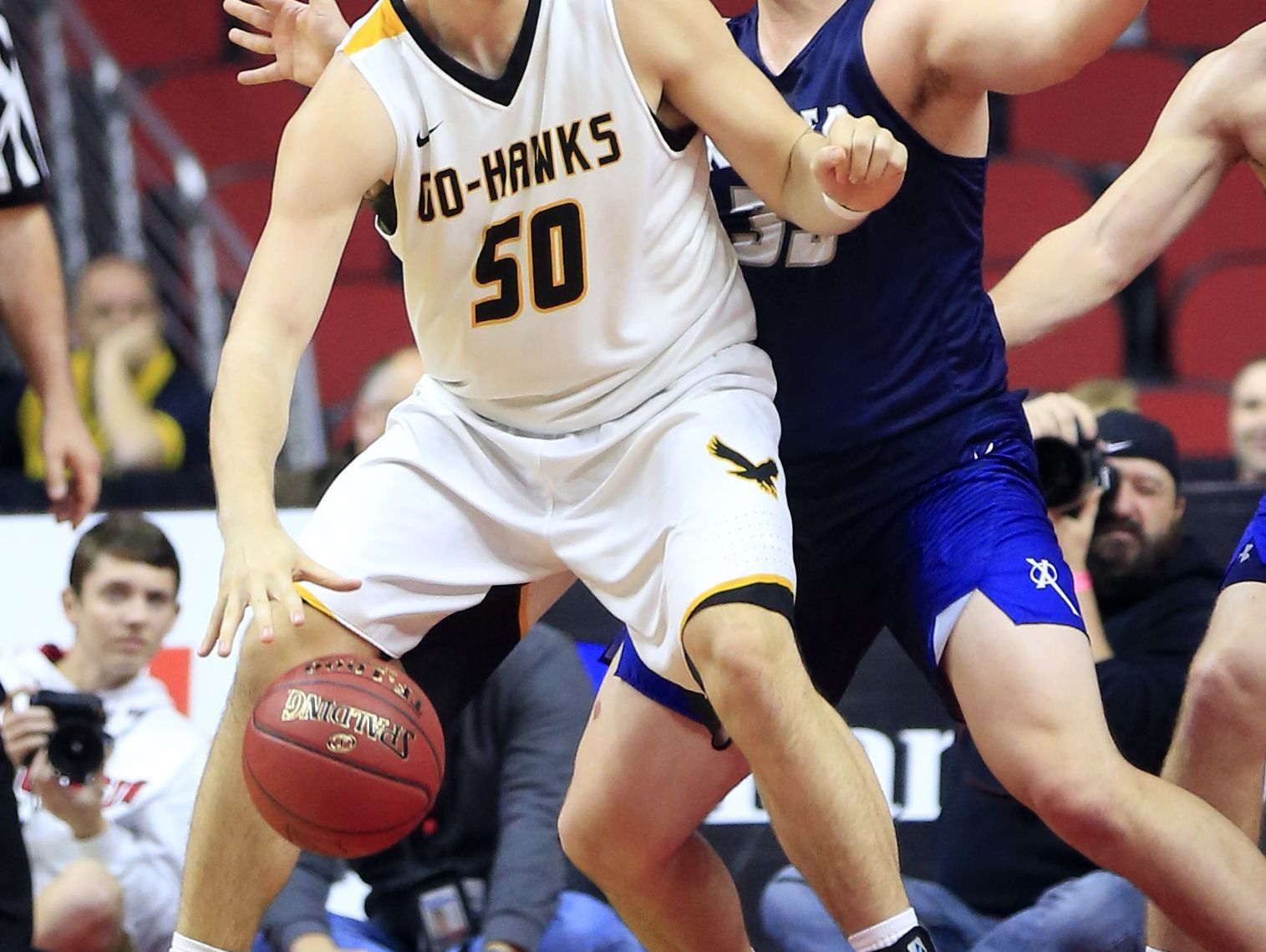 Austin Phyfe of Waverly-Shell Rock drives to the basket in the 3A semifinal game against Cedar Rapids Xavier Thursday, March 9, 2017.