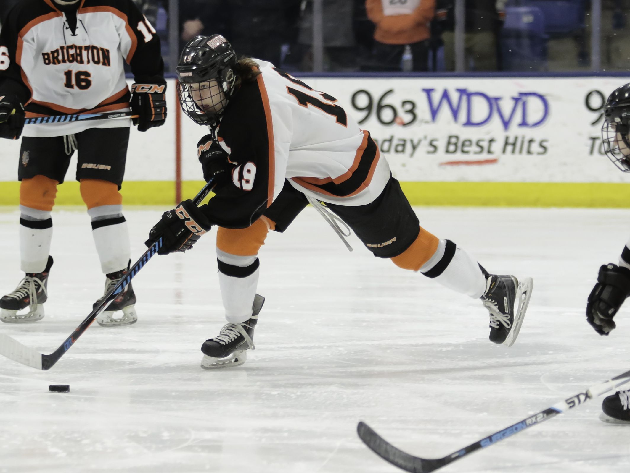 Brighton's Keith Wikman carries the puck in a 5-0 victory over Northville in the state hockey semifinals Friday.