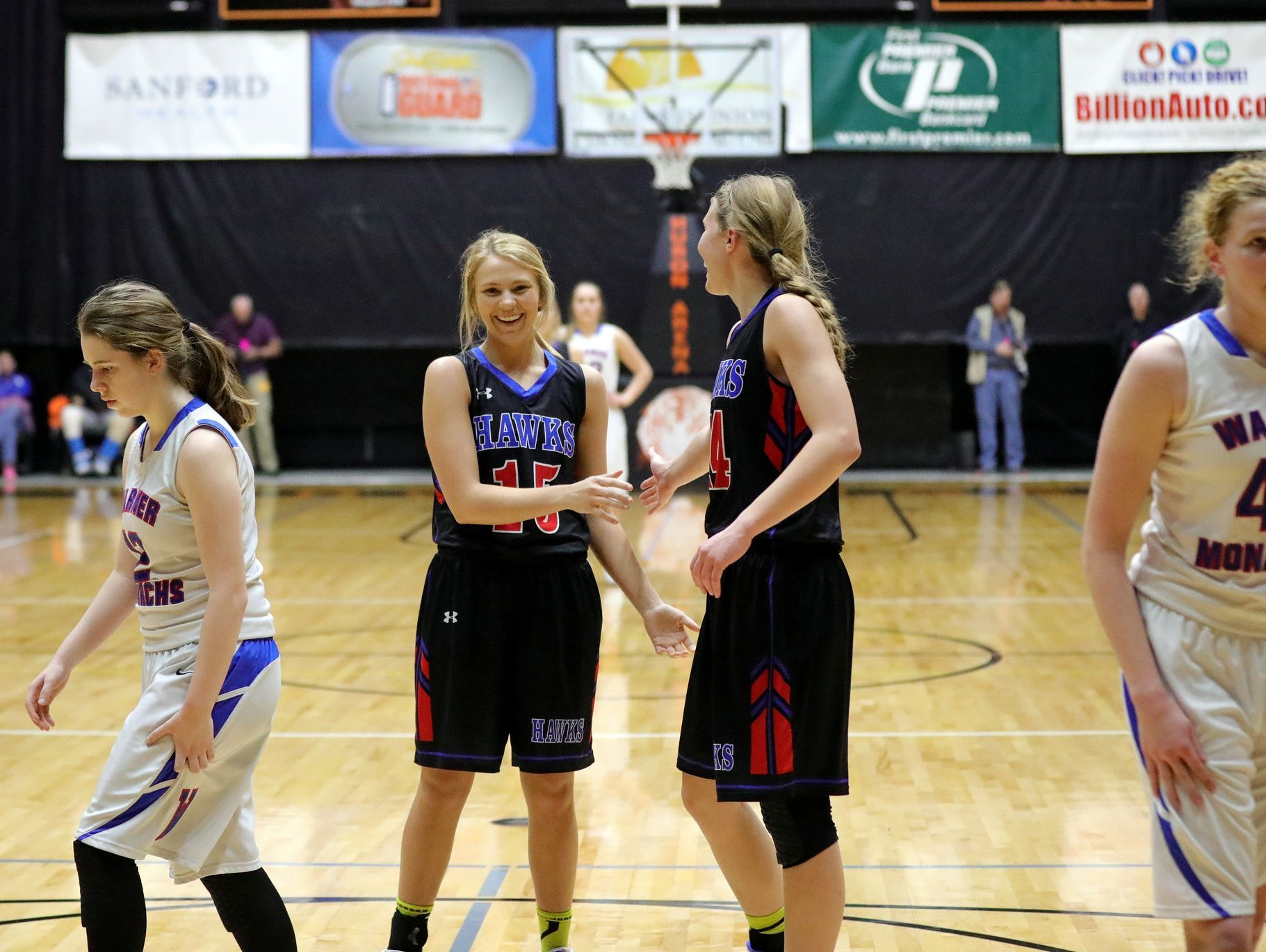 Sarah Morgan (left) is congratulated by teammate Myah Selland during Friday's Class B semifinal in Huron.