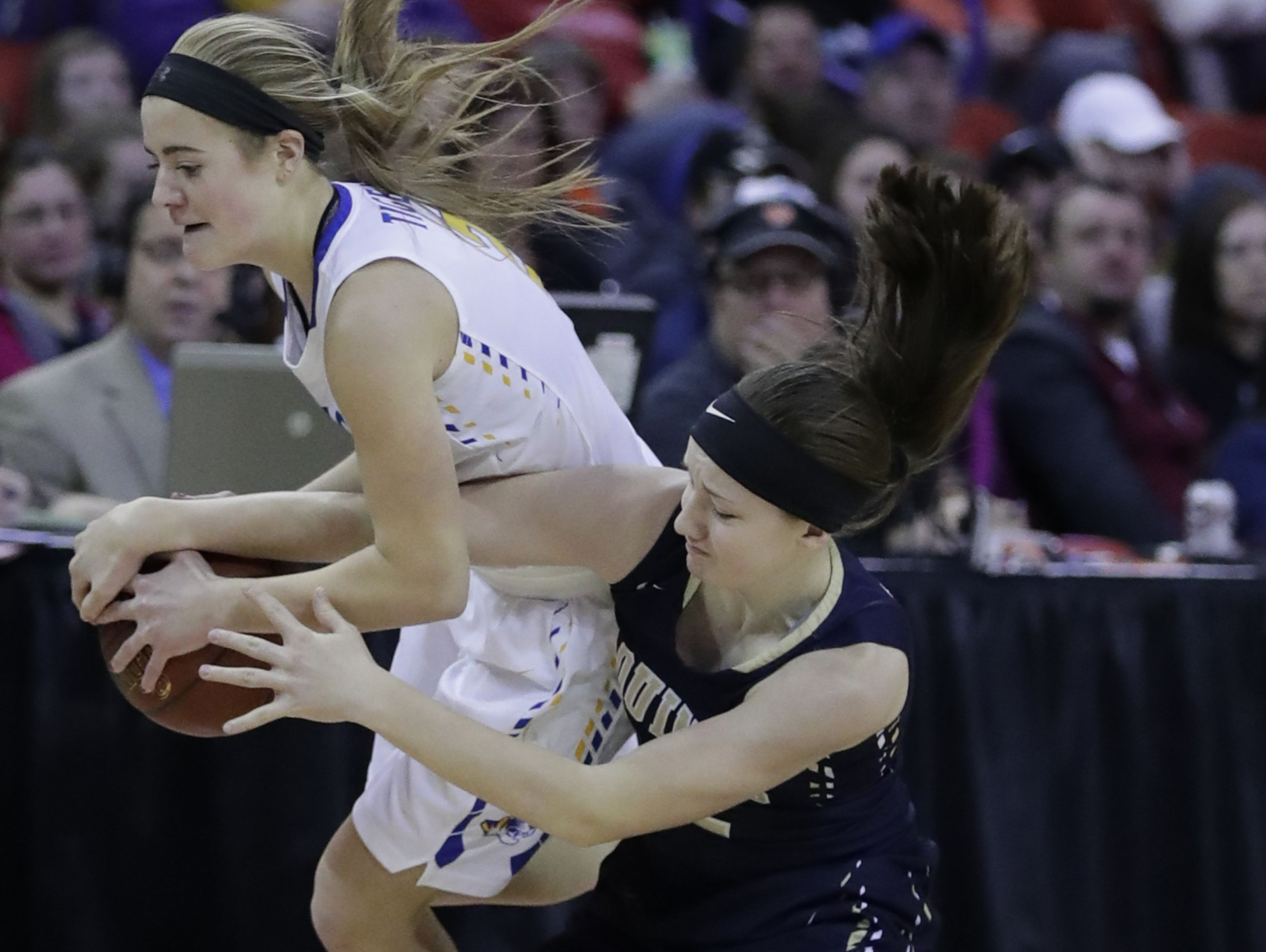 Howards Grove's Ashley Reinemann, left, battles for a loose ball against Aquinas' Kayla Bahr during the WIAA Division 4 State Tournament final girls basketball game Friday at the Resch Center.
