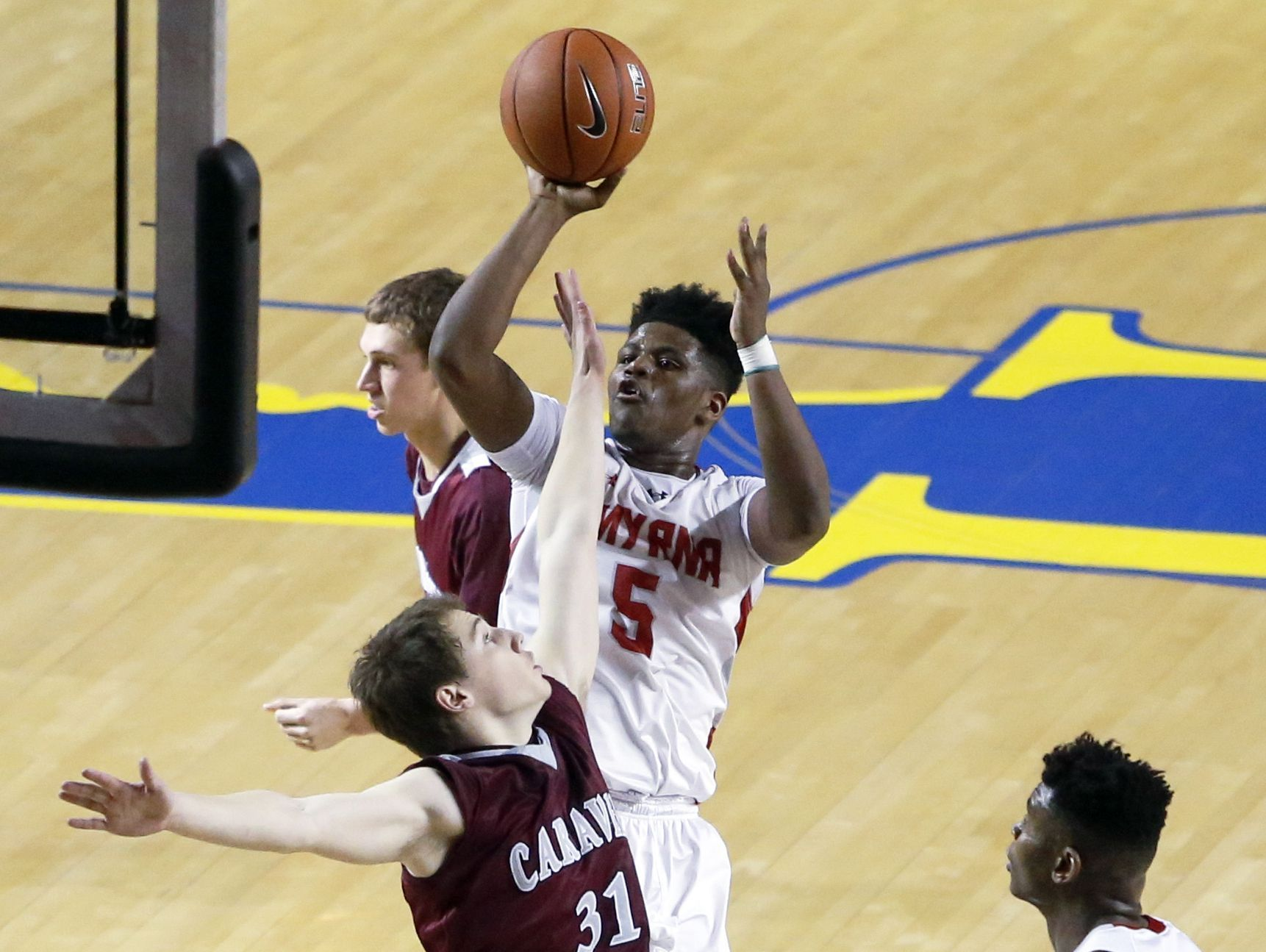 Smyrna's Jaymeir Garnett shoots over Caravel's Joe Lange in the second half of the Eagles' 61-53 win in the DIAA state tournament title game at the Bob Carpenter Center Saturday.
