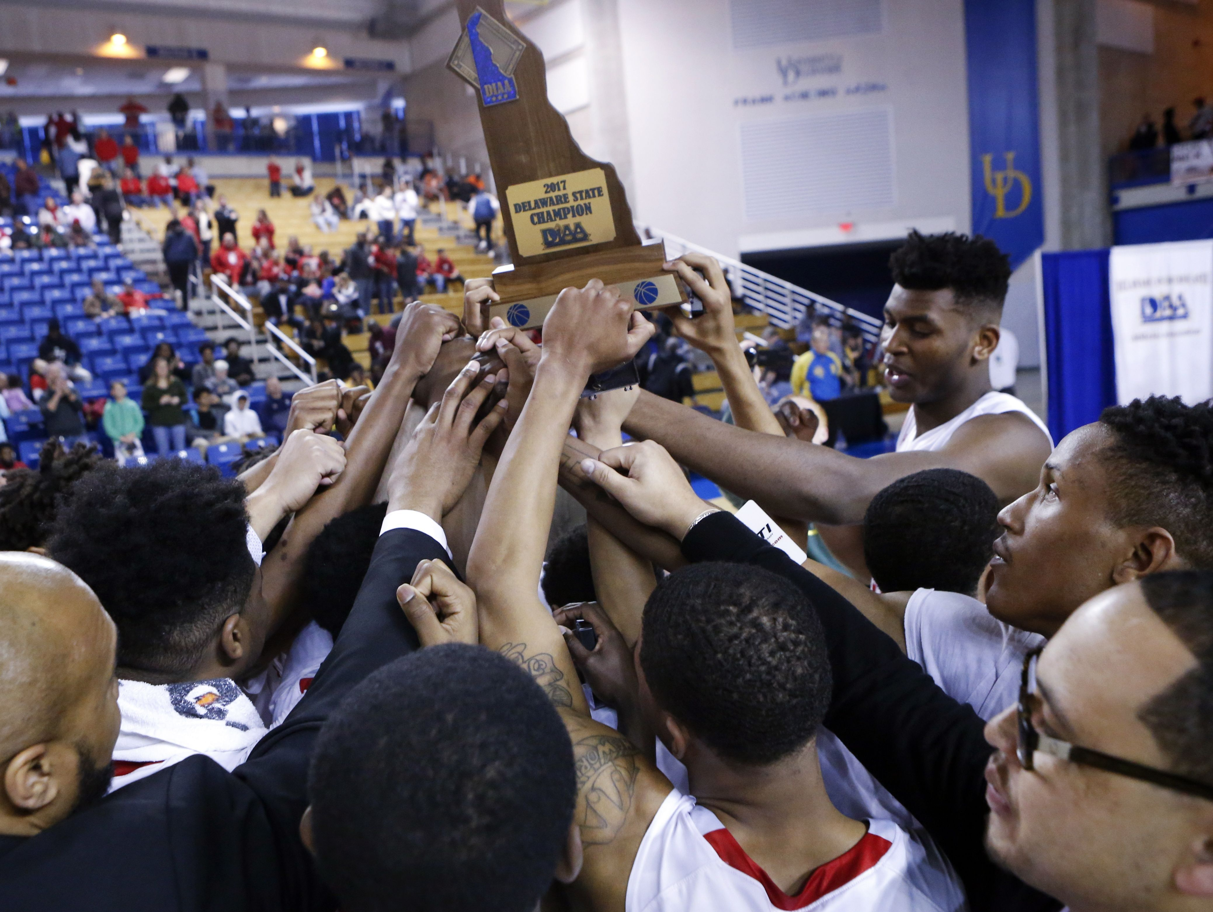 Smyrna celebrates its championship after the Eagles' 61-53 win against Caravel in the DIAA state tournament title game at the Bob Carpenter Center Saturday.