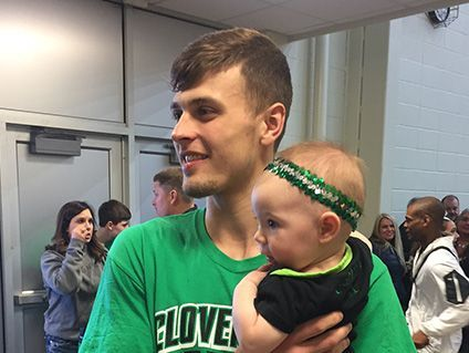 Cooper Neese holds Sadie Rempe after Cloverdale's season-ending loss Saturday to Northeastern.