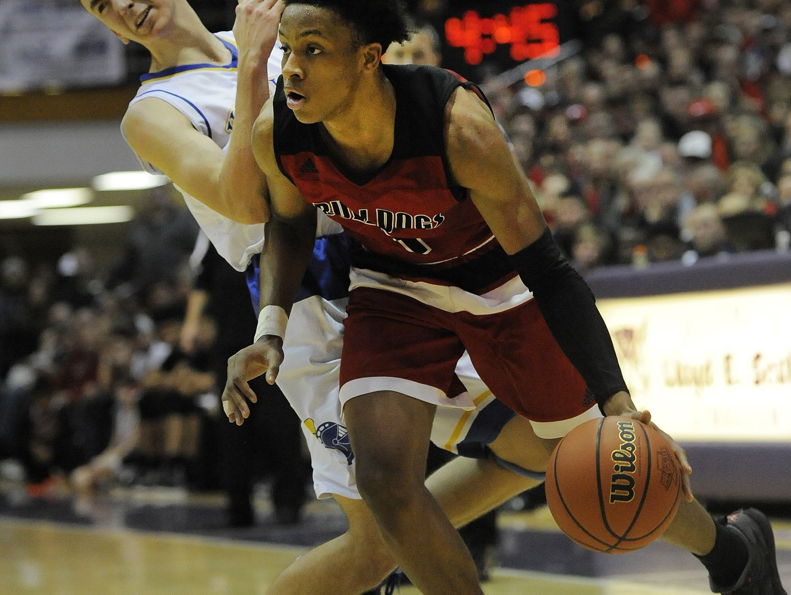 New Albany's Romeo Langford (right) drives around against Castle's Alex Hemenway (left) on Saturday in the 2017 IHSAA 4A Regional Basketball Final at Seymour High School. Castle won 72-64. (Photo by David Lee Hartlage, Special to The Courier-Journal) Mar. 11, 2017