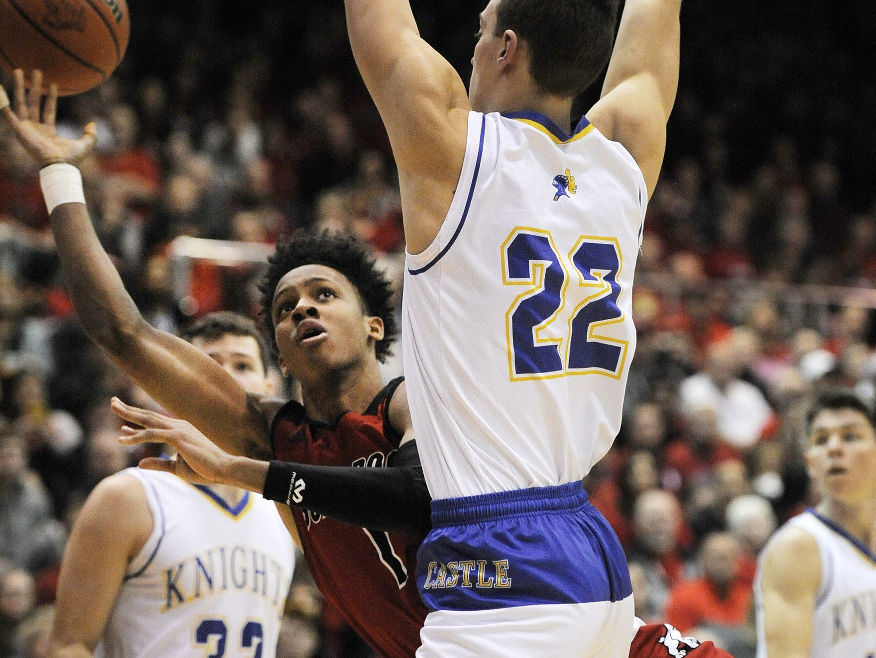 New Albany's Romeo Langford (left) tries to shoot around the defense of Castle's Jack Nunge (22) on Saturday in the 2017 IHSAA 4A Regional Basketball Final at Seymour High School. Castle won 72-64. (Photo by David Lee Hartlage, Special to The Courier-Journal) Mar. 11, 2017