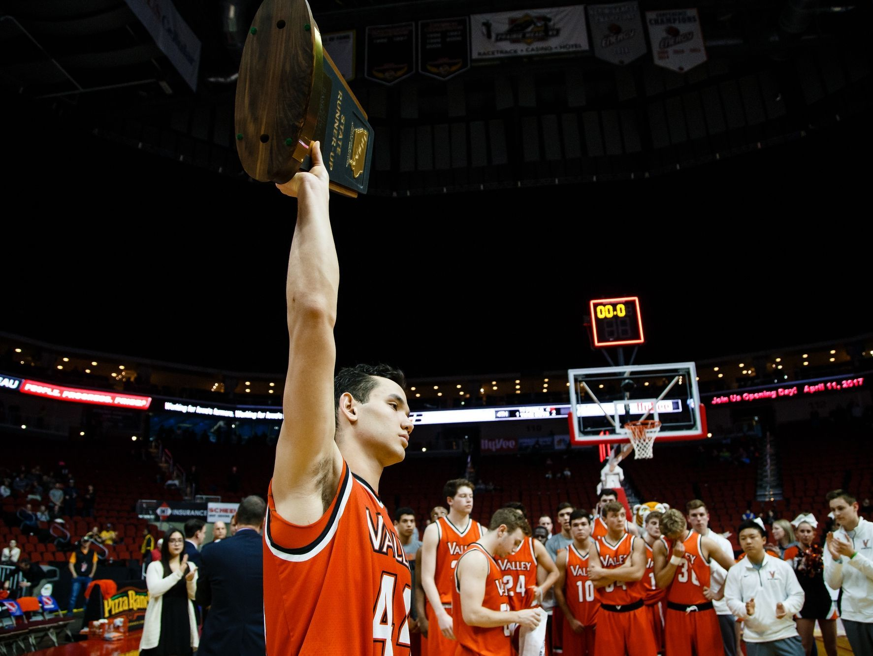 Valley's Quinton Curry (44) raises the runner up trophy after Valley lost, 50-64 to Iowa City West during their 4A state basketball championship game on Saturday, March 11, 2017, in Des Moines.