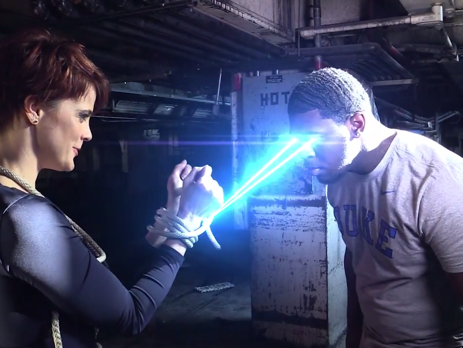 Waggener High football player Tahj Rice (right, with lasers emitting from his eyes), rescues a damsel in distress, played by Tana Leggo, in a video produced by the Courier-Journal.