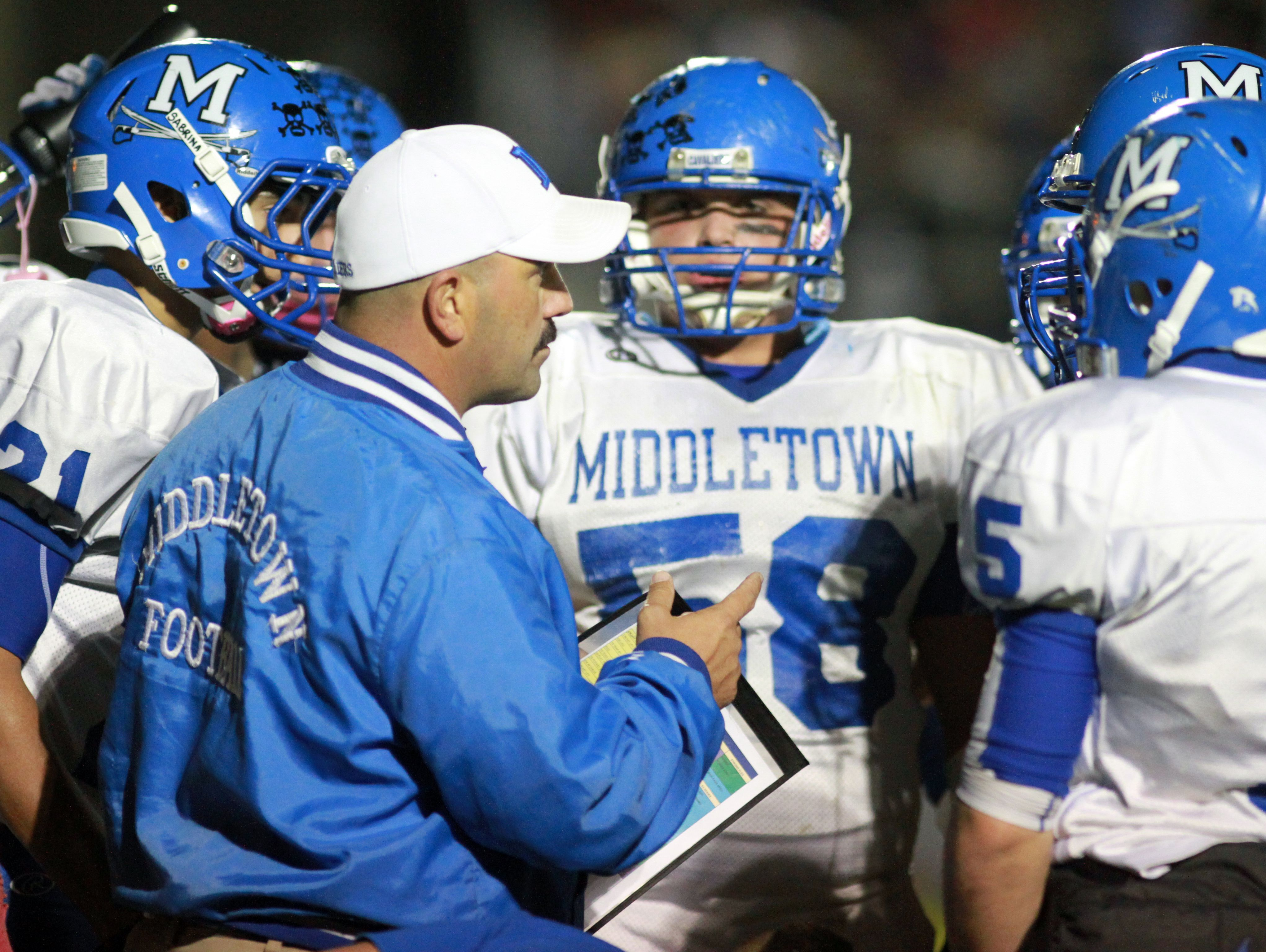 Middletown coach Mark DelPercio works with his team in a second quarter break.