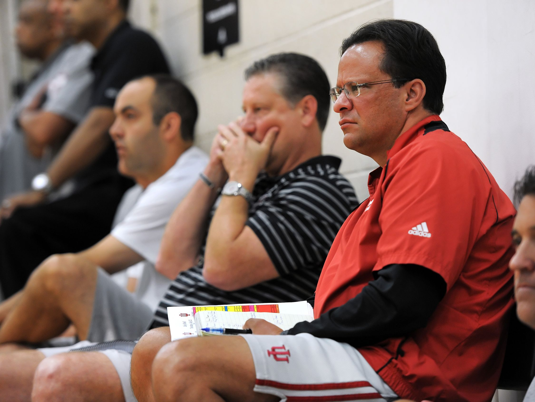 FILE – Tom Crean watches possible player prospects as he sits on the baseline with other coaches from around the country during the AAU Adidas Invitational held at North Central High School and other various locations throughout Indianapolis on July 11, 2013.
