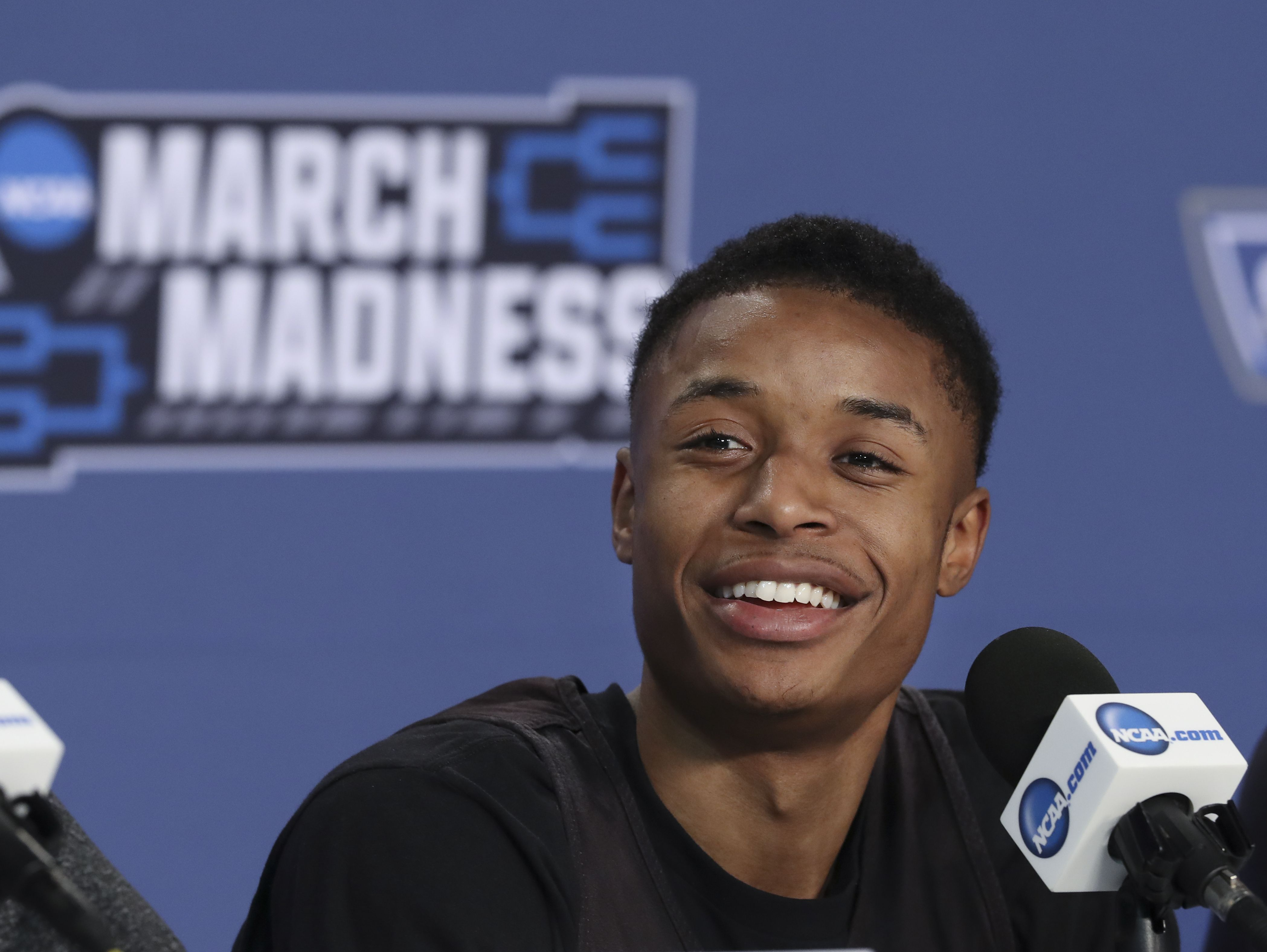 NKU's Lavone Holland II (30) speaks to the media at the Bankers Life Fieldhouse in Indianapolis ahead of the first round of the NCAA Tournament. Mar. 16, 2017