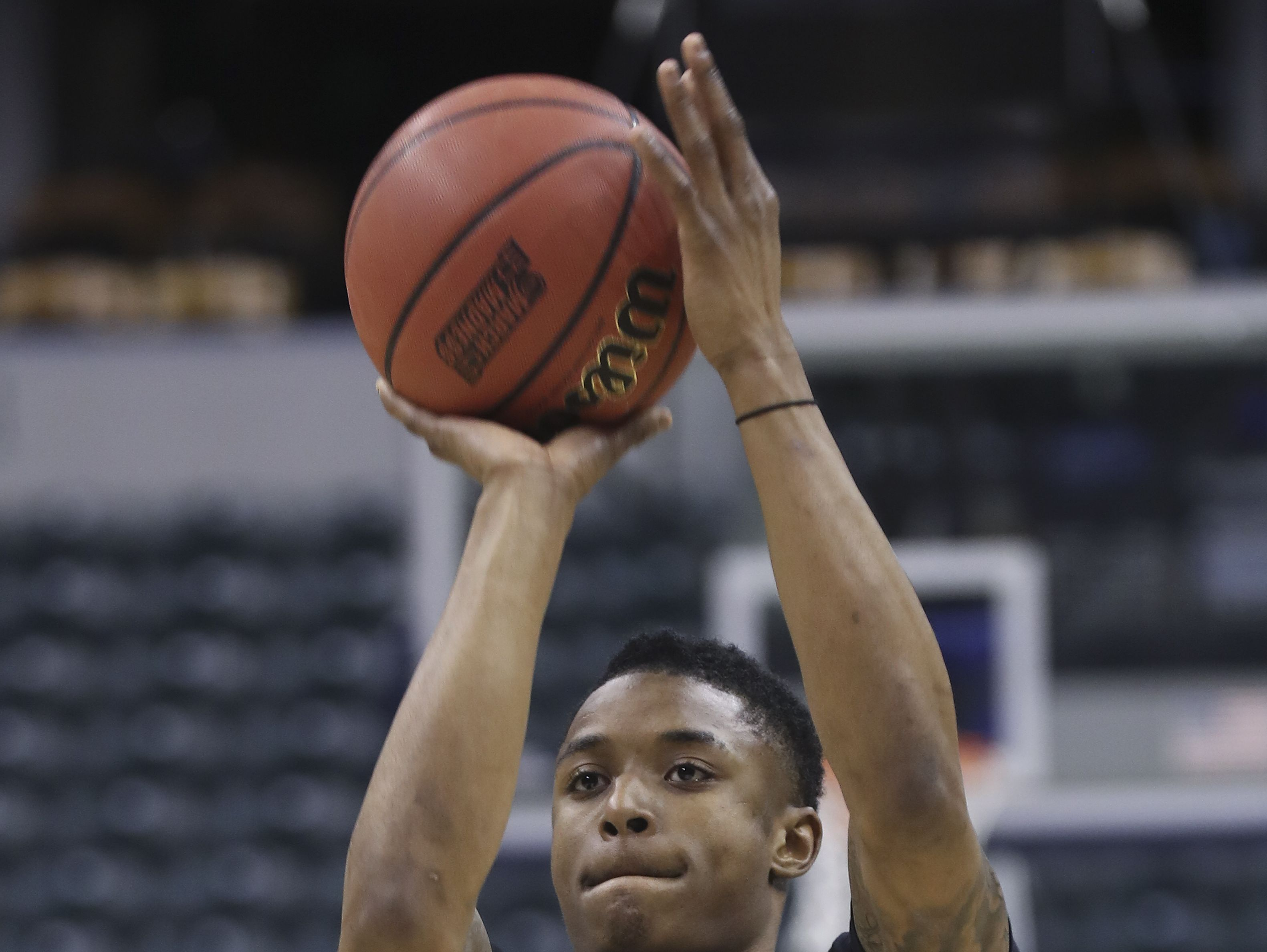 NKU's Lavone Holland II (30) shoots a jumper during practice at the Bankers Life Fieldhouse in Indianapolis ahead of the first round of the NCAA Tournament. Mar. 16, 2017