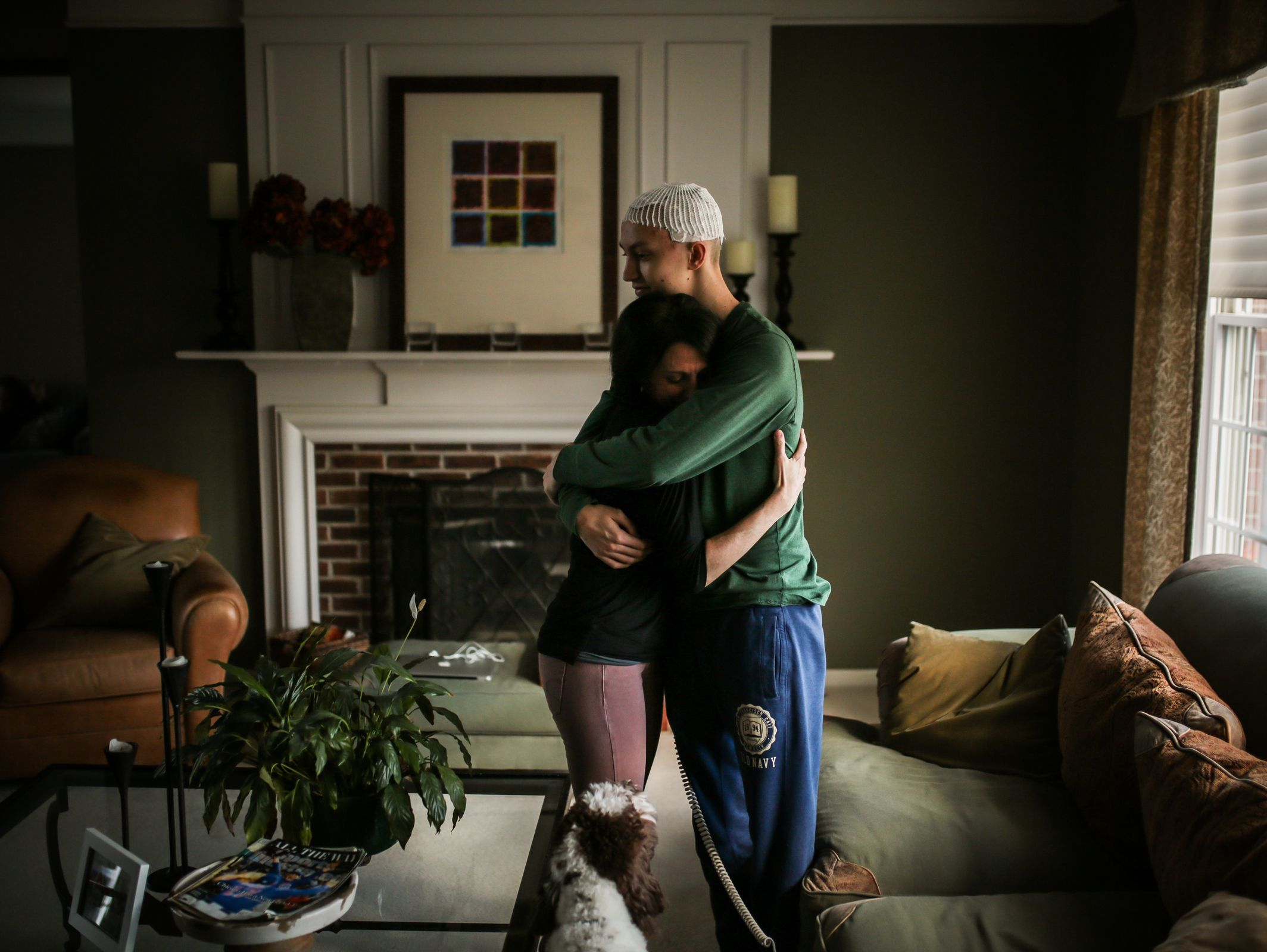 Gina Kell-Spehn, 47, of Rochester, MI, hugs her son, Sam Kell, 16, of Rochester, MI, in the living room of their home on Saturday March 11, 2017 in Rochester, MI. Kell is sophomore at Rochester Stoney Creek High School and is battling a form of brain cancer.