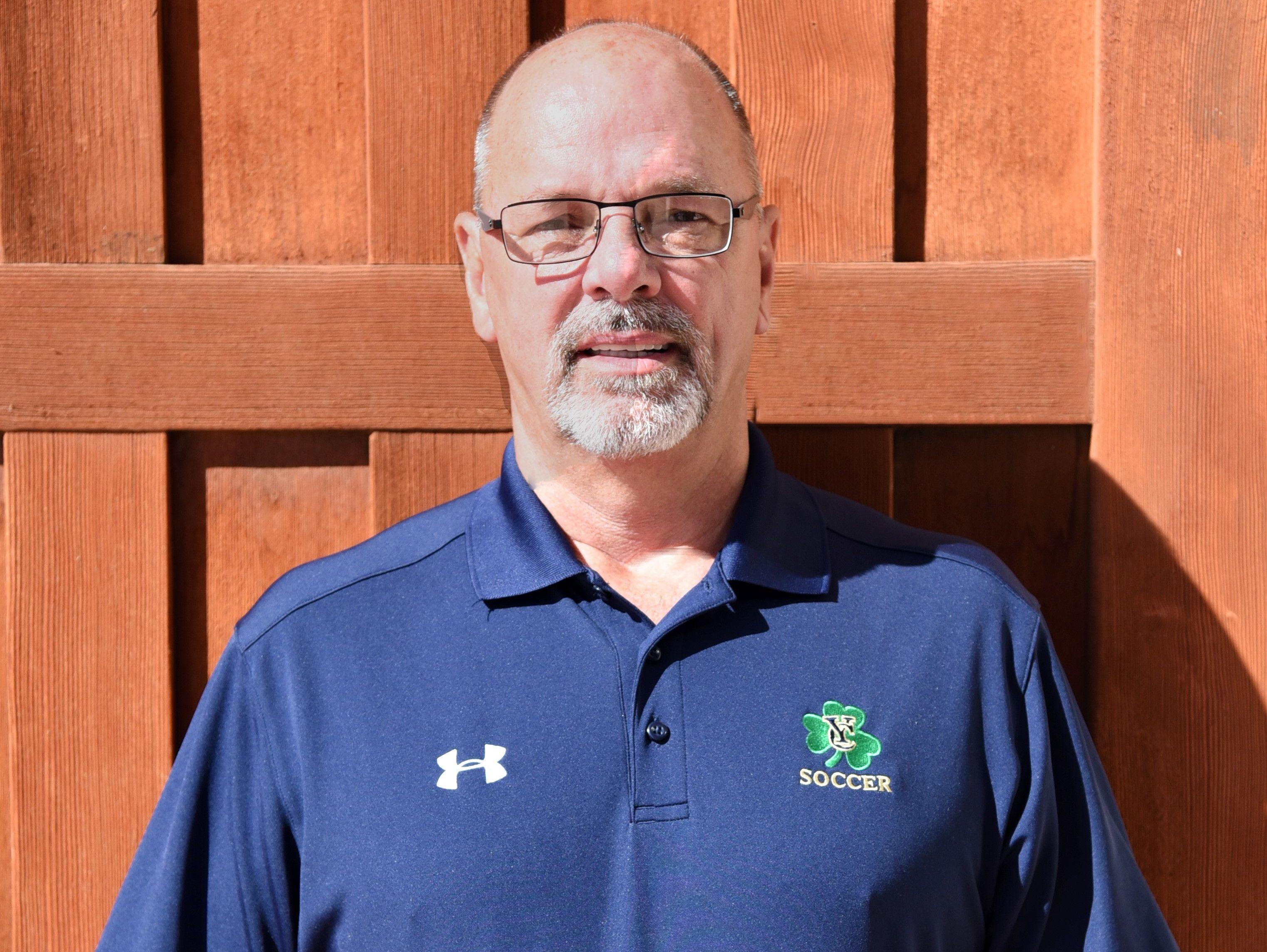 Yuma Catholic boys soccer coach Ralph Evans is the azcentral.com Sports Awards Small Schools Boys Soccer Coach of the Year.