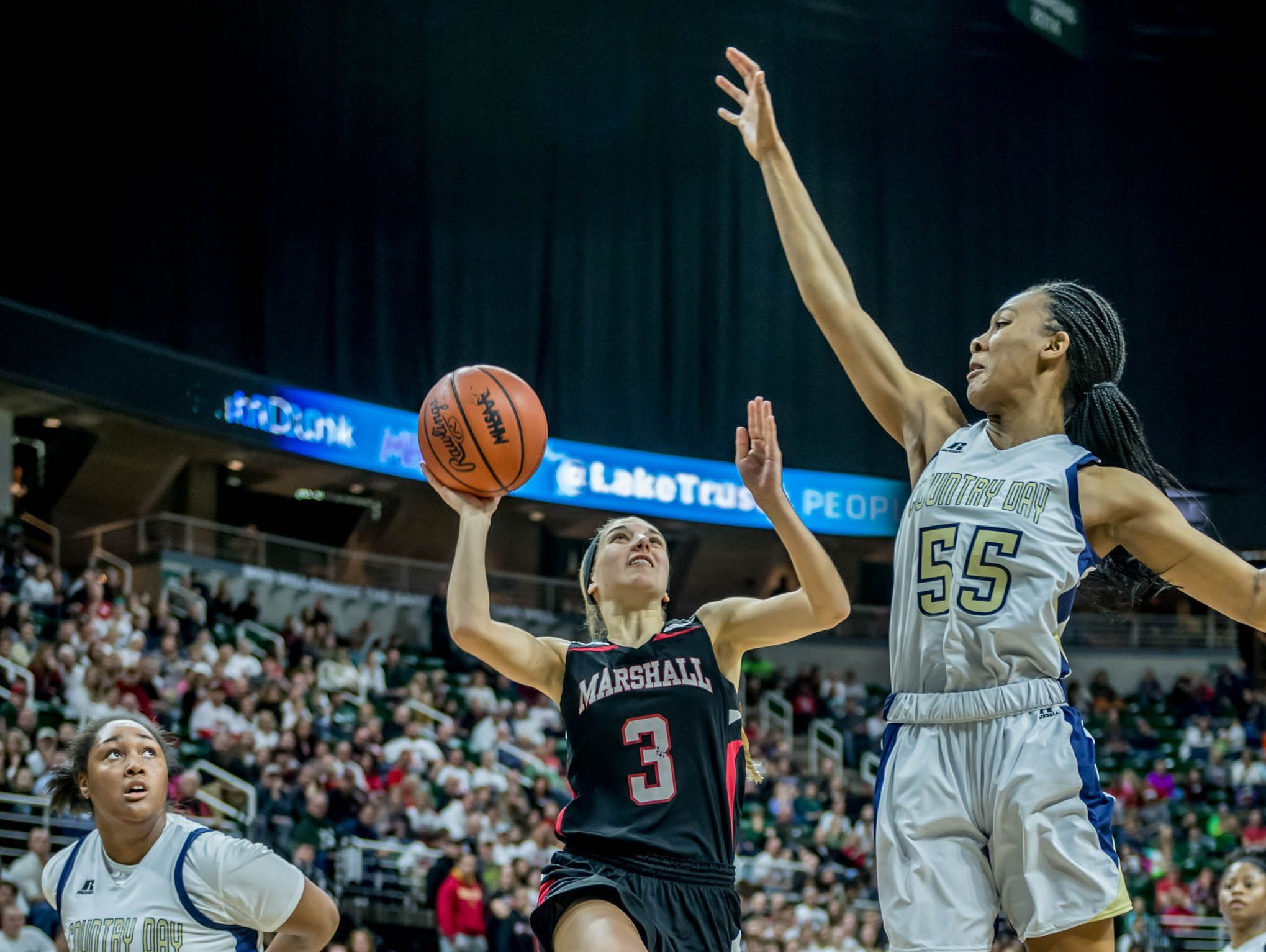 Marshall's Carlee Long (3) goes for the as Detroit Country Day's Tylar Bennett defends during the Class B state semifinal on Friday at the Breslin Center in East Lansing.