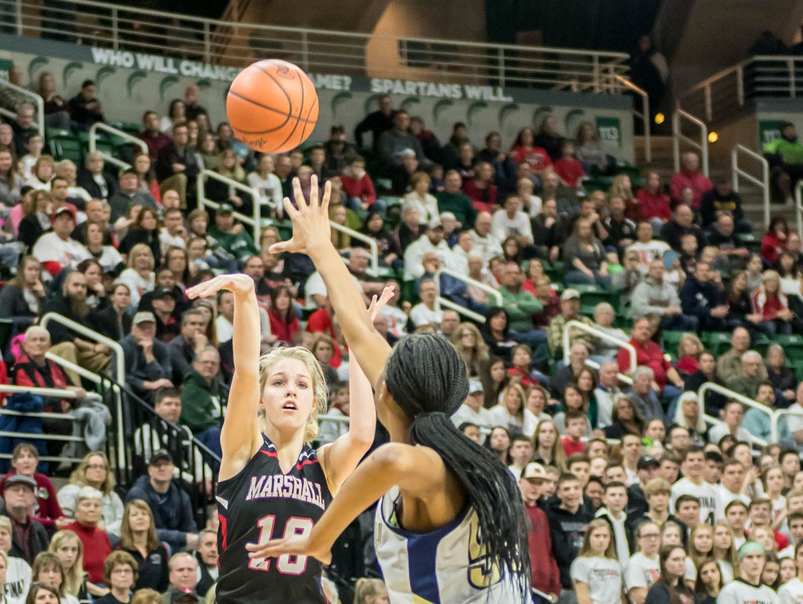 Marshall's Natalie Tucker goes for the 3-pointer during first half action against Dertroit Country Day at the Class B state semifinal Friday evening.