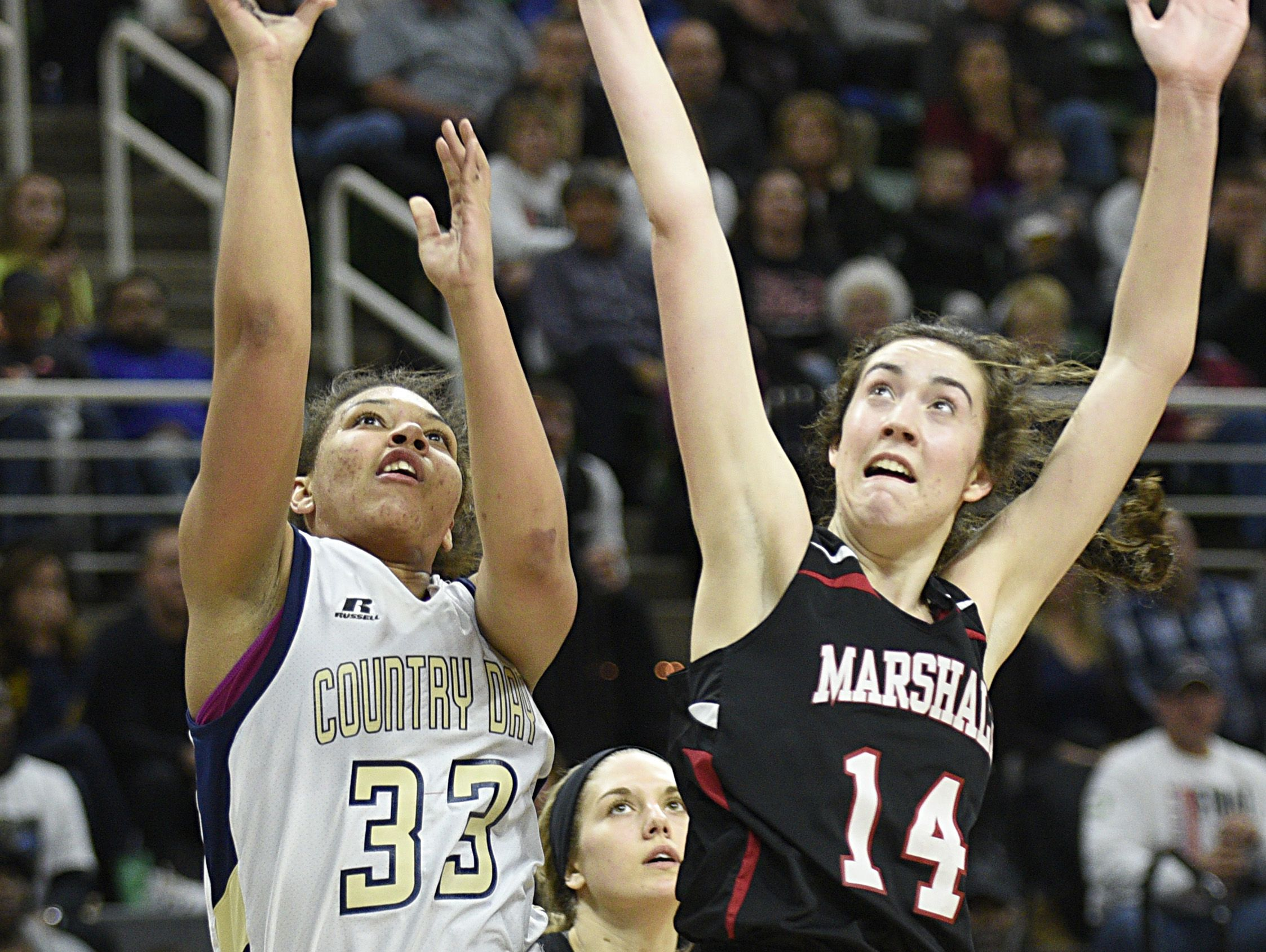 Detroit Country Day's Destiny Lewis (33) shoots over Marshall's Georgianna Partley (14).