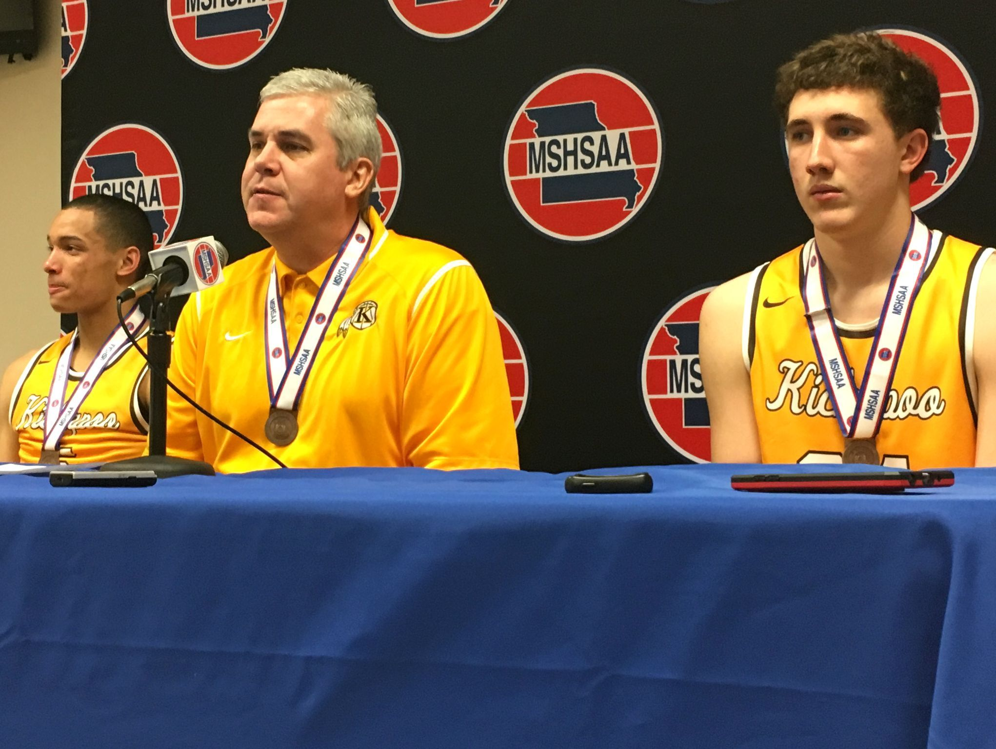 From left, Kickapoo senior Cameron Davis, boys basketball coach Dick Rippee and senior Jared Ridder address reporters following an 89-78 win over Chaminade at Mizzou Arena Saturday, March 18, 2017.