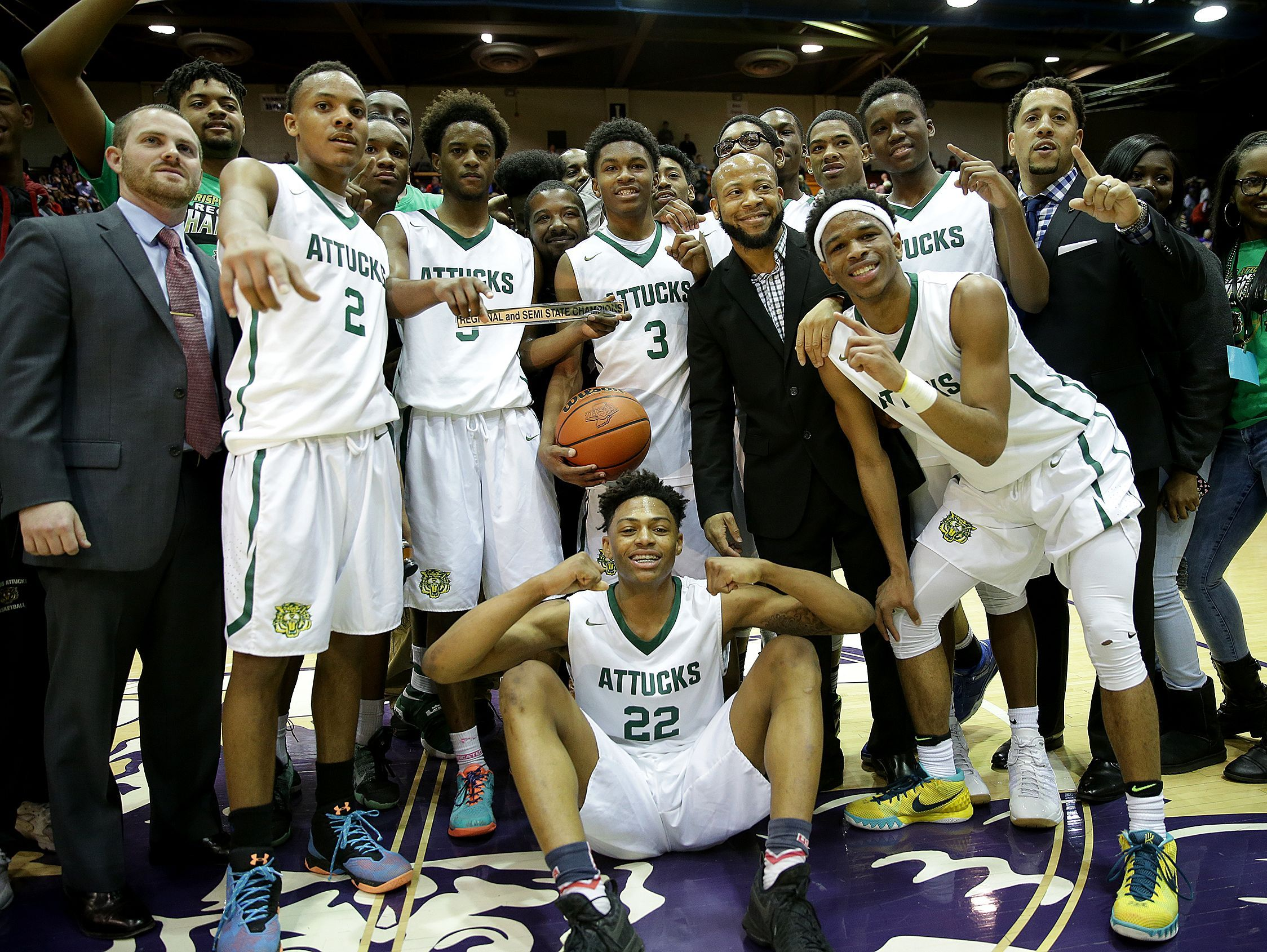 The Crispus Attucks Tigers celebrates their IHSAA boys semi-state win Saturday, March 18, 2017, afternoon in Seymour IN. Crispus Attucks Tigers defeated the Bosse Bulldogs to advance to their first boys state title game since 1959.