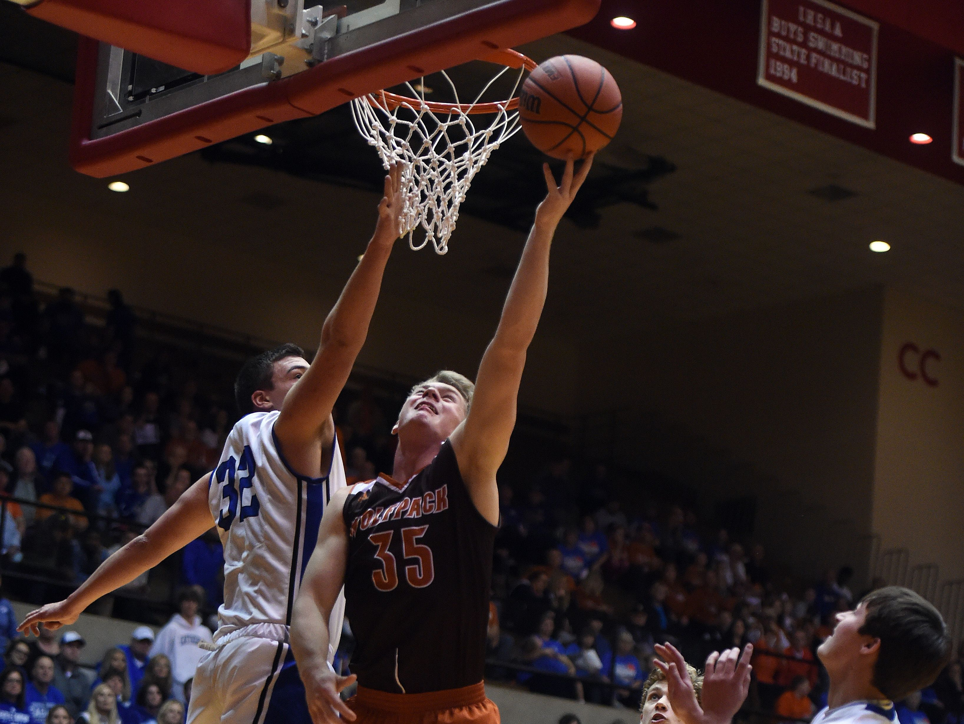 Crawford County's Matthew Dearborn puts the ball up against Heritage Christian's Zack Meus Saturday, March 18, 2017 during the Class 2A basketball semi-state championship in the Tiernan Center at Richmond.