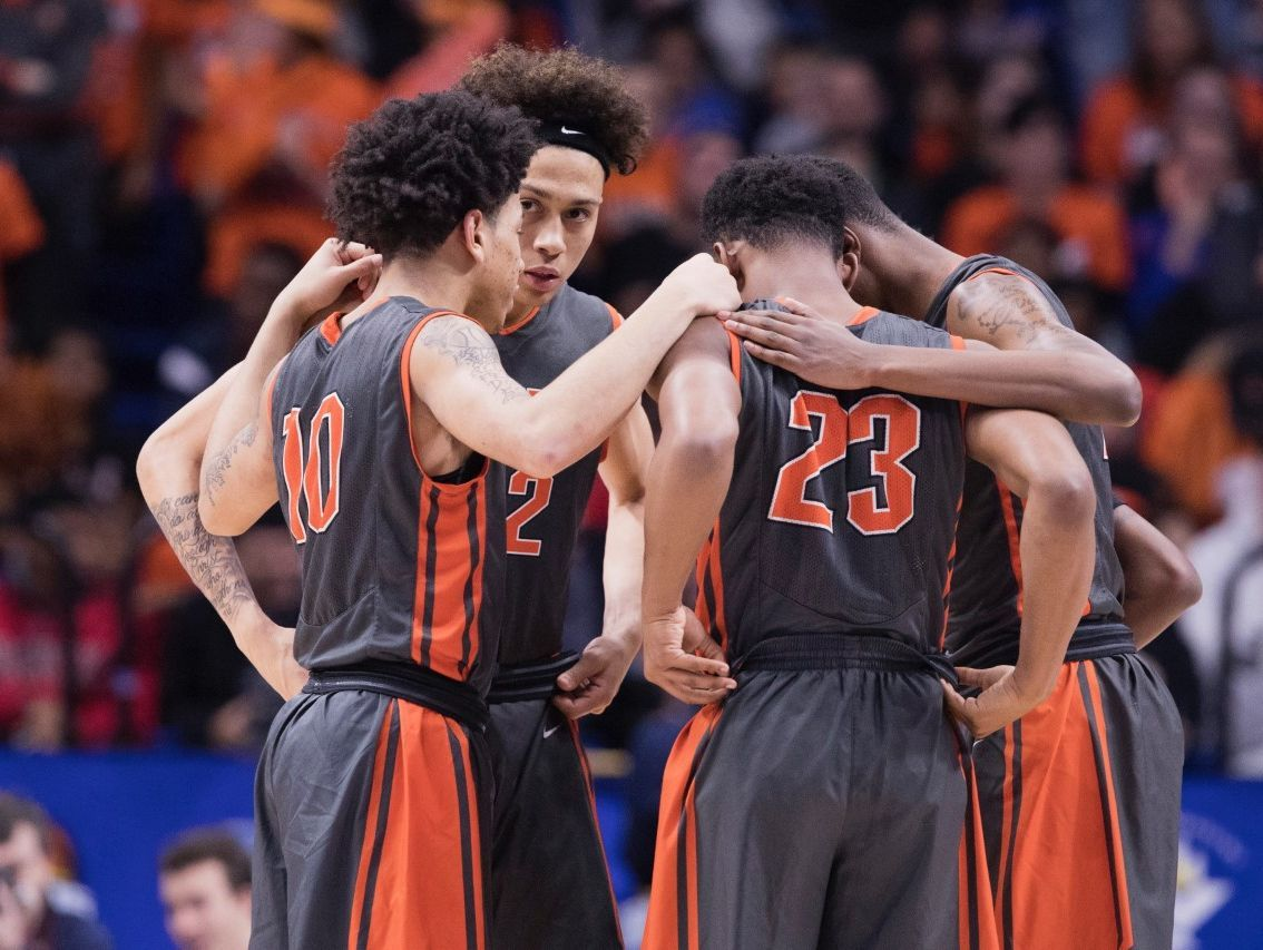 Fern Creek players huddle during Saturday's Sweet 16 semifinal game against Cooper at Rupp Arena.