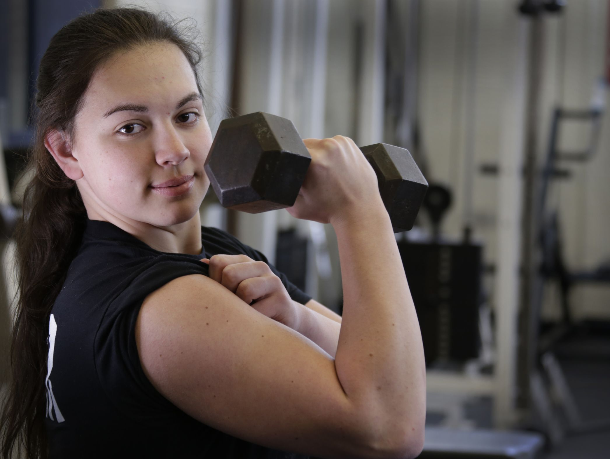16-year-old Molly Likins of St. Clair is photographed here at St. Clair High School Tuesday Mar. 14, 2017. She just set the state powerlifting bench press record of the 181 pound division by bench pressing 190 pounds.