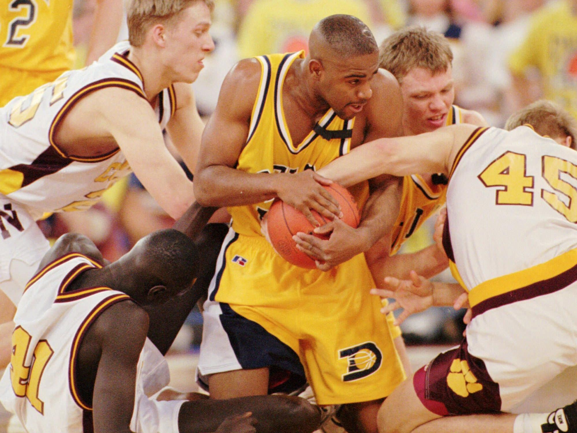 Delta and Bloomington North players battle for a loose ball in the 1997 IHSAA state championship game.
