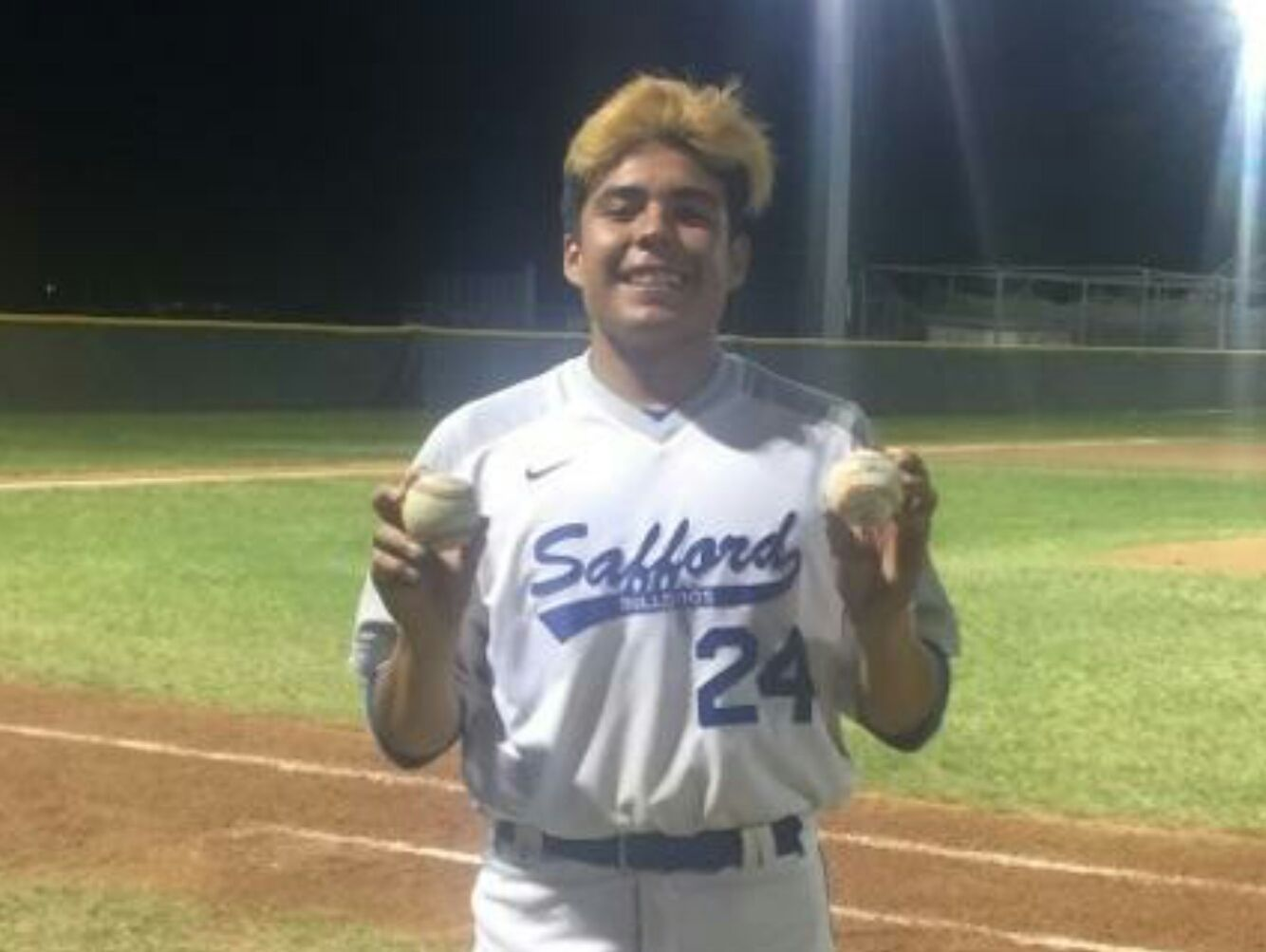 Safford pitcher Gabe Ornelas holds up two baseballs, representing his back-to--back no-hitters.