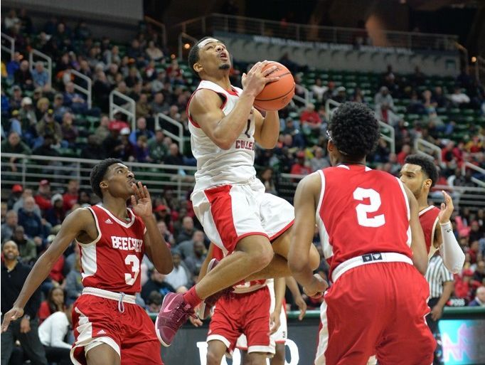 Detroit Edison junior Pierre Mitchell Jr. attempts a shot against Flint Beecher in Thursday's Class C semifinal at the Breslin Center. Beecher won, 76-68, and will try to claim its third consecutive state title on Saturday.