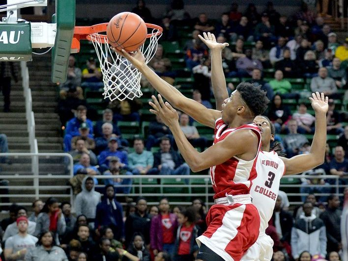 Flint Beecher freshman Earnest Sanders attempts a shot against Detroit Edison's Amari Hudson in Thursday's Class C semifinal at the Breslin Center in East Lansing. Beecher won, 76-68, and will try to claim its third consecutive state title on Saturday.