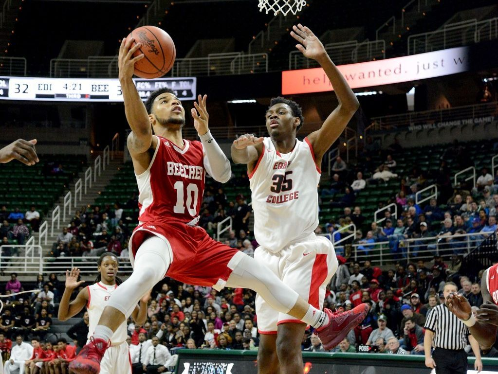 Flint Beecher senior Malik Ellison attempts a shot against Detroit Edison's Deante Johnson in Thursday's Class C semifinal at the Breslin Center in East Lansing. Beecher won, 76-68, and will try to claim its third consecutive state title on Saturday.