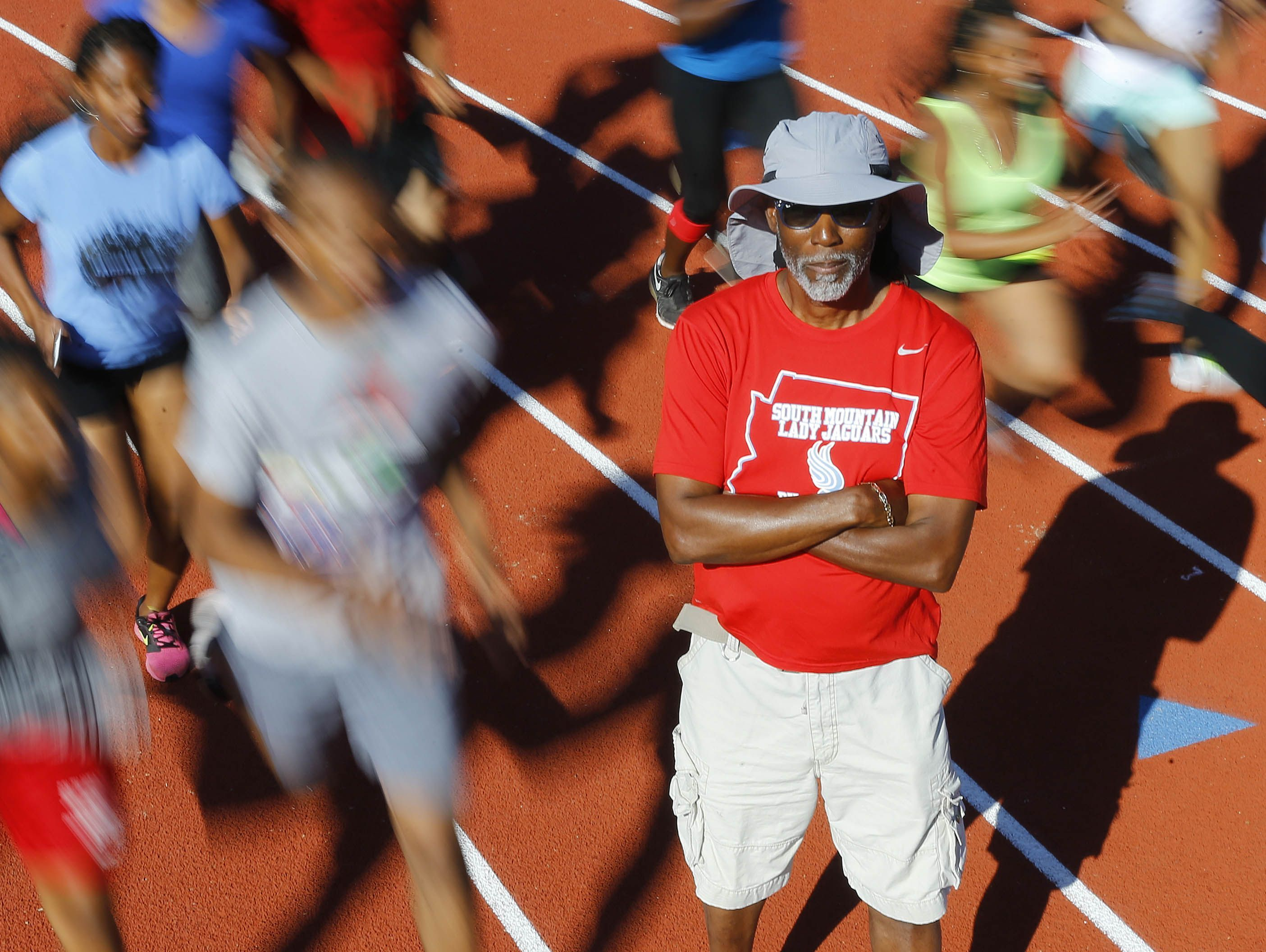 South Mountain track coach Dwayne Evans Tuesday, Mar. 21, 2017 in Phoenix, Ariz. Evans set a state record in the 200 in 1976 that still stands. He won an Olympic bronze medal that year right out of high school.