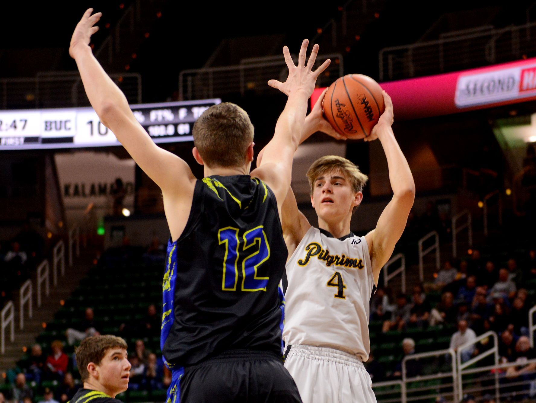 Lansing Christian's Kyle Lebeda looks to pass as Buckley's Austin Harris tries to block during the MHSAA state semifinal against Buckley on Thursday, March 23, 2017 at the Breslin Center in East Lansing.
