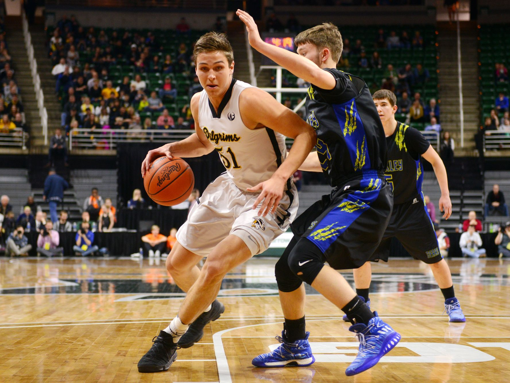 Lansing Christian's Preston Granger tries to dribble past Buckley's Brock Beeman during the state semifinal against Buckley on Thursday, March 23, 2017 at the Breslin Center in East Lansing.