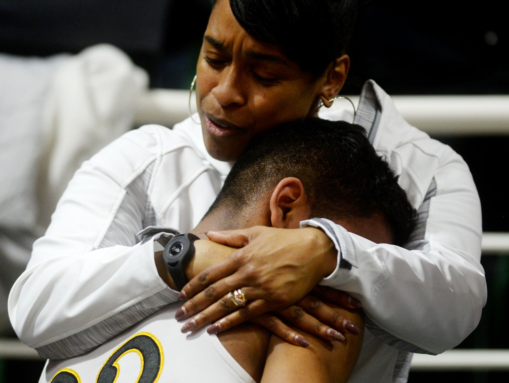 Lansing Christian's Forrest Bouyer is comforted after the team's loss in the Class D state semifinals against Buckley on Thursday, March 23, 2017 at the Breslin Center in East Lansing. Buckley won, 68-61.