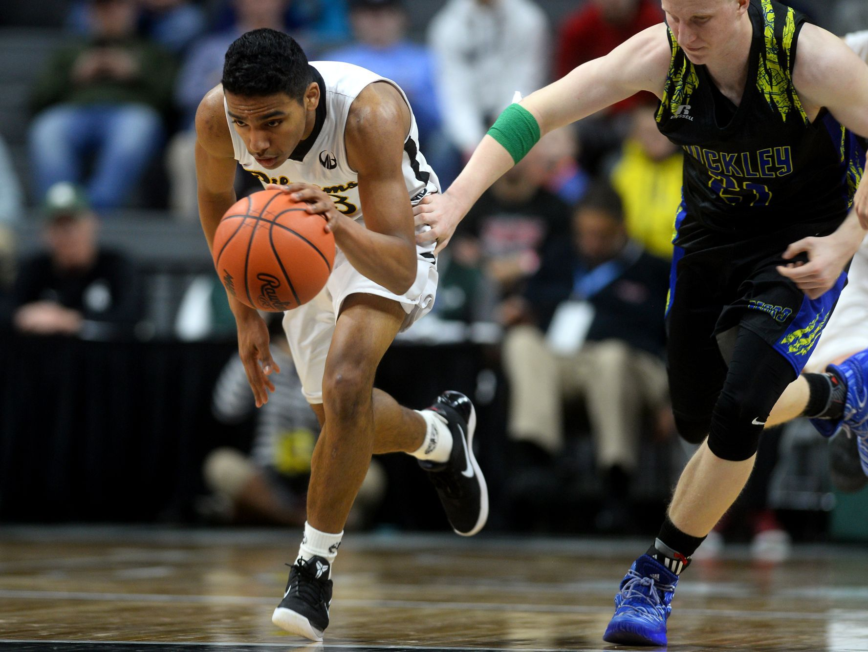 Lansing Christian's Forrest Bouyer drives the ball down the court during the Class D state semifinals against Buckley on Thursday, March 23, 2017 at the Breslin Center in East Lansing. Buckley won, 68-61.