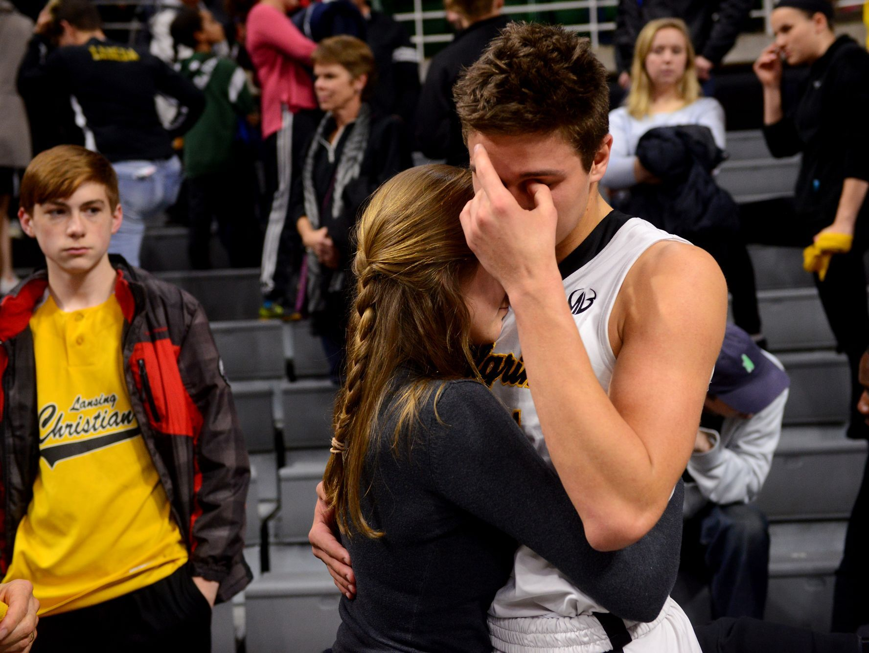 Briley Brogan comforts Lansing Christian's Preston Granger after the team's loss in the Class D state semifinals against Buckley on Thursday, March 23, 2017 at the Breslin Center in East Lansing. Buckley won, 68-61.