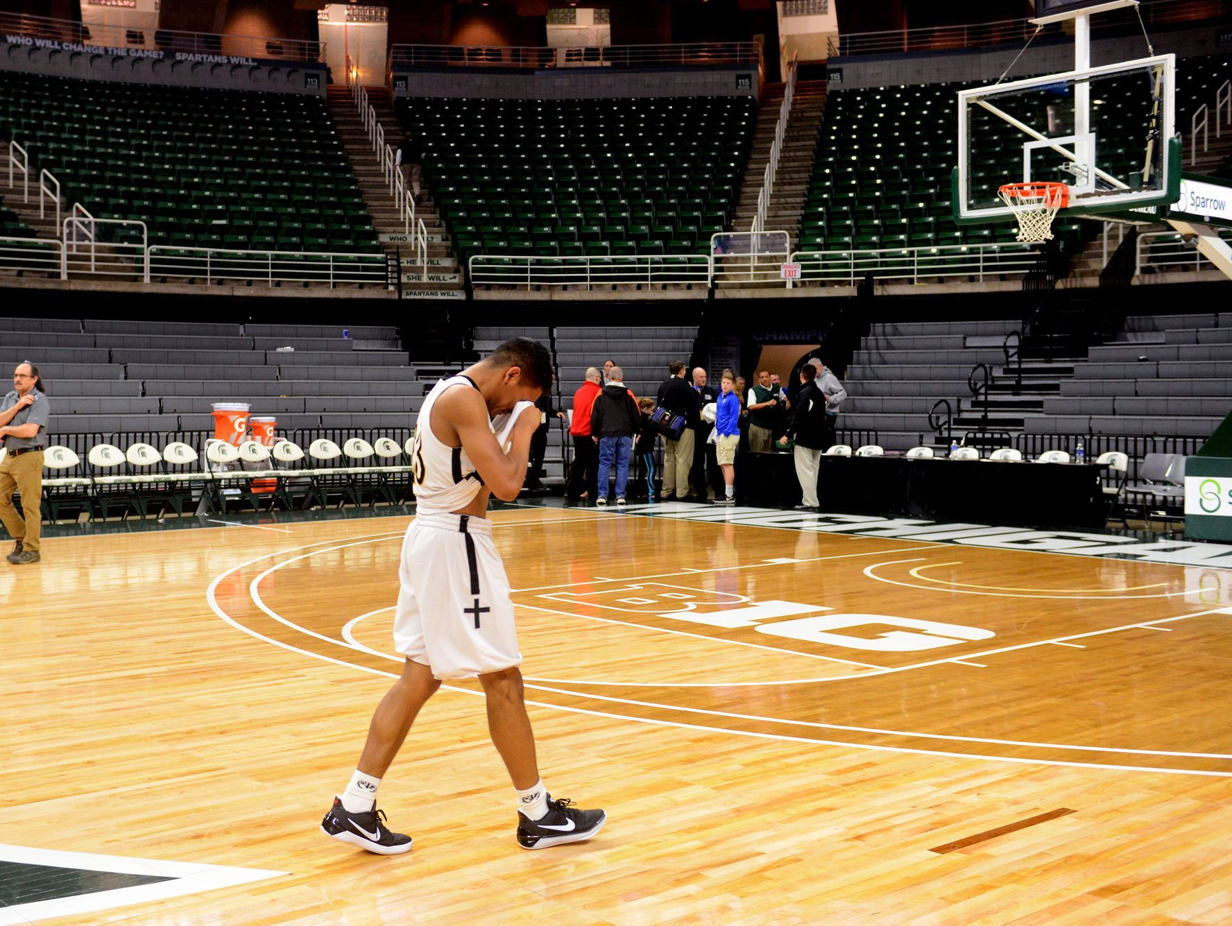 Lansing Christian's Forrest Bouyer walks off the court after the team's loss in the Class D state semifinals against Buckley on Thursday, March 23, 2017 at the Breslin Center in East Lansing. Buckley won, 68-61.
