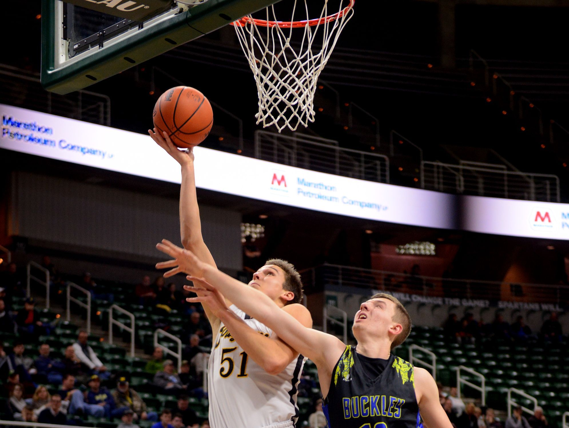 Lansing Christian's Preston Granger goes up to the basket as Buckley's Austin Harris tries to block during the Class D state semifinals against Buckley on Thursday, March 23, 2017 at the Breslin Center in East Lansing. Buckley won, 68-61.