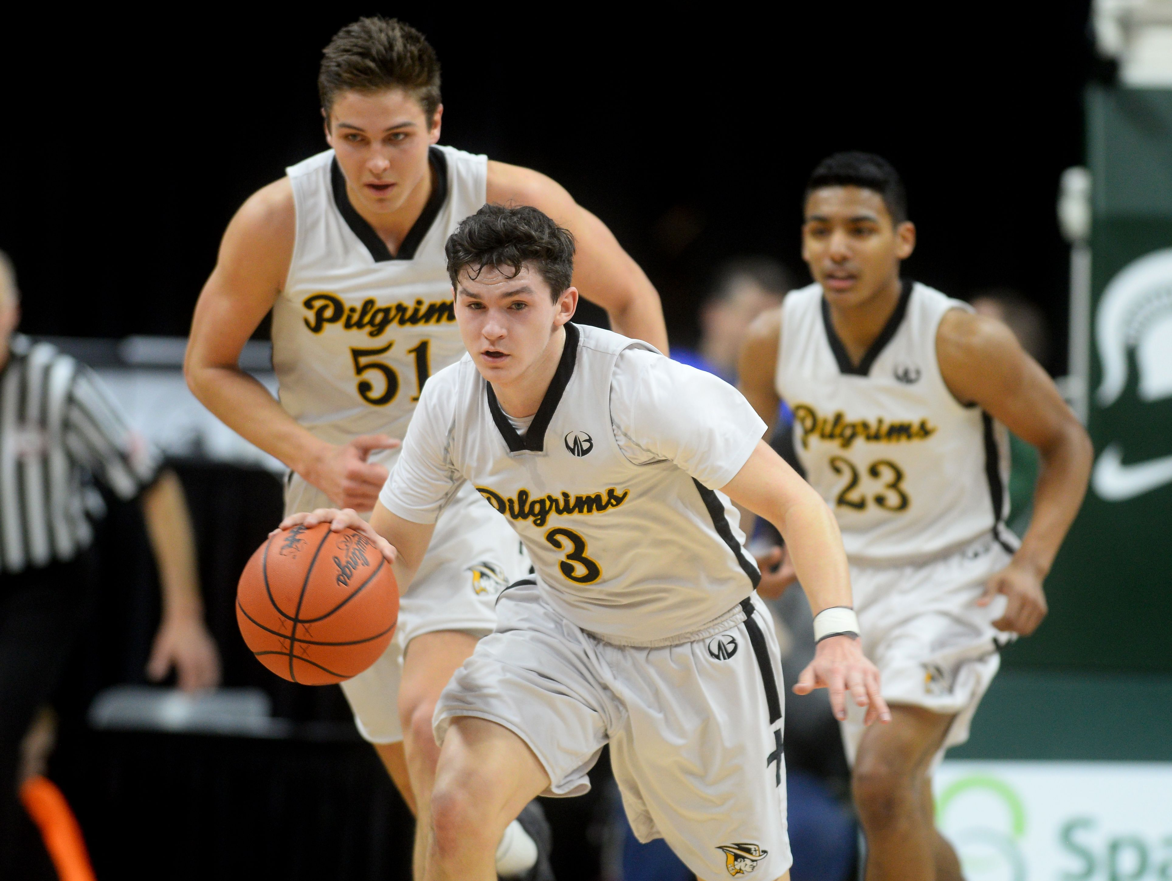 Lansing Christian's Matt Havey runs the ball down the court during the Class D state semifinals against Buckley on Thursday, March 23, 2017 at the Breslin Center in East Lansing. Buckley won, 68-61.