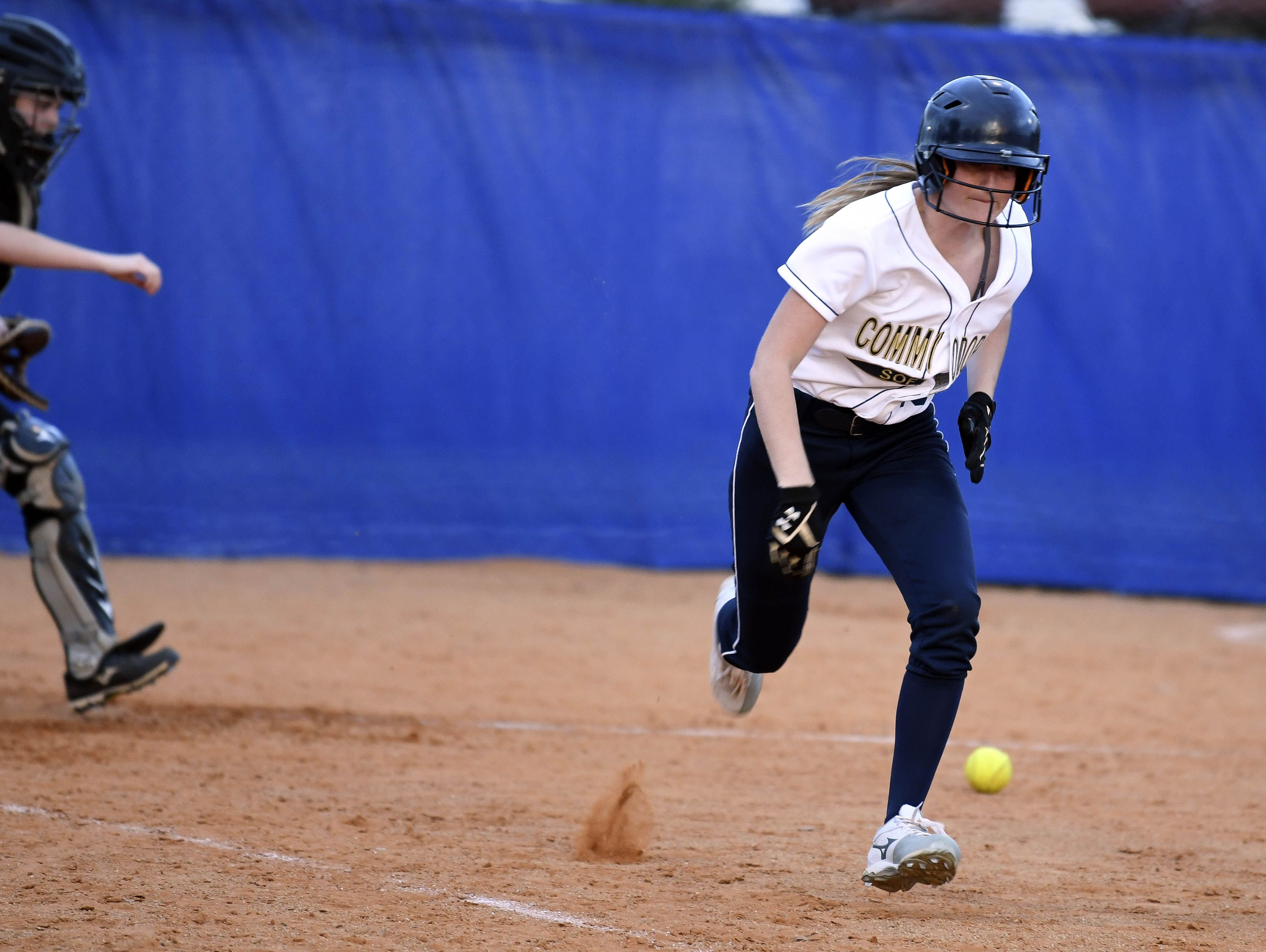 Eau Gallie's Heather Hartz runs out a bunt in a game against Bayside.