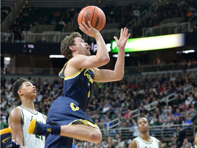 Clarkston junior guard Foster Loyer goes up for a shot against West Bloomfield in the Class A semifinal at the Breslin Center on Friday, March 24, 2017. Loyer scored 32 points in Clarkston's 78-35 win.