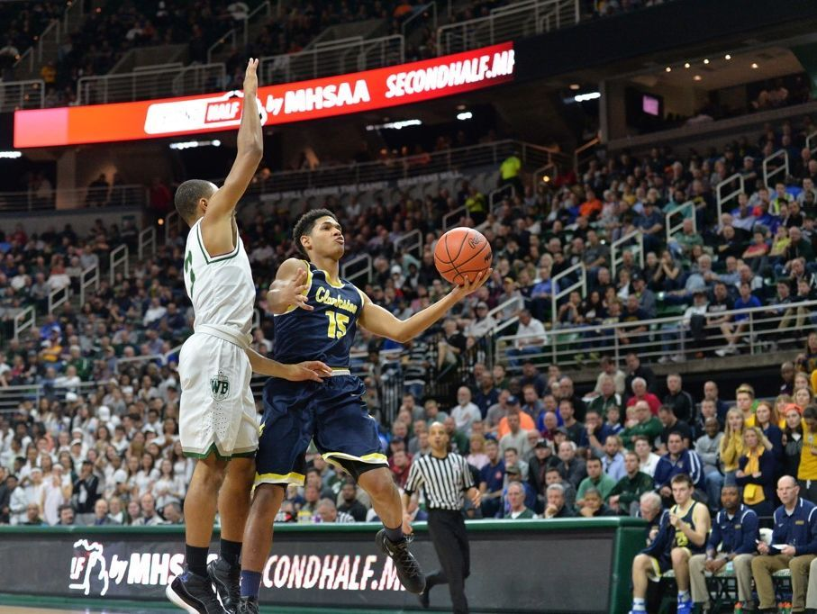 Clarkston junior guard Tieler Houston goes up for a shot against West Bloomfield in the Class A semifinal at the Breslin Center on Friday, March 24, 2017. Clarkston won, 78-35.