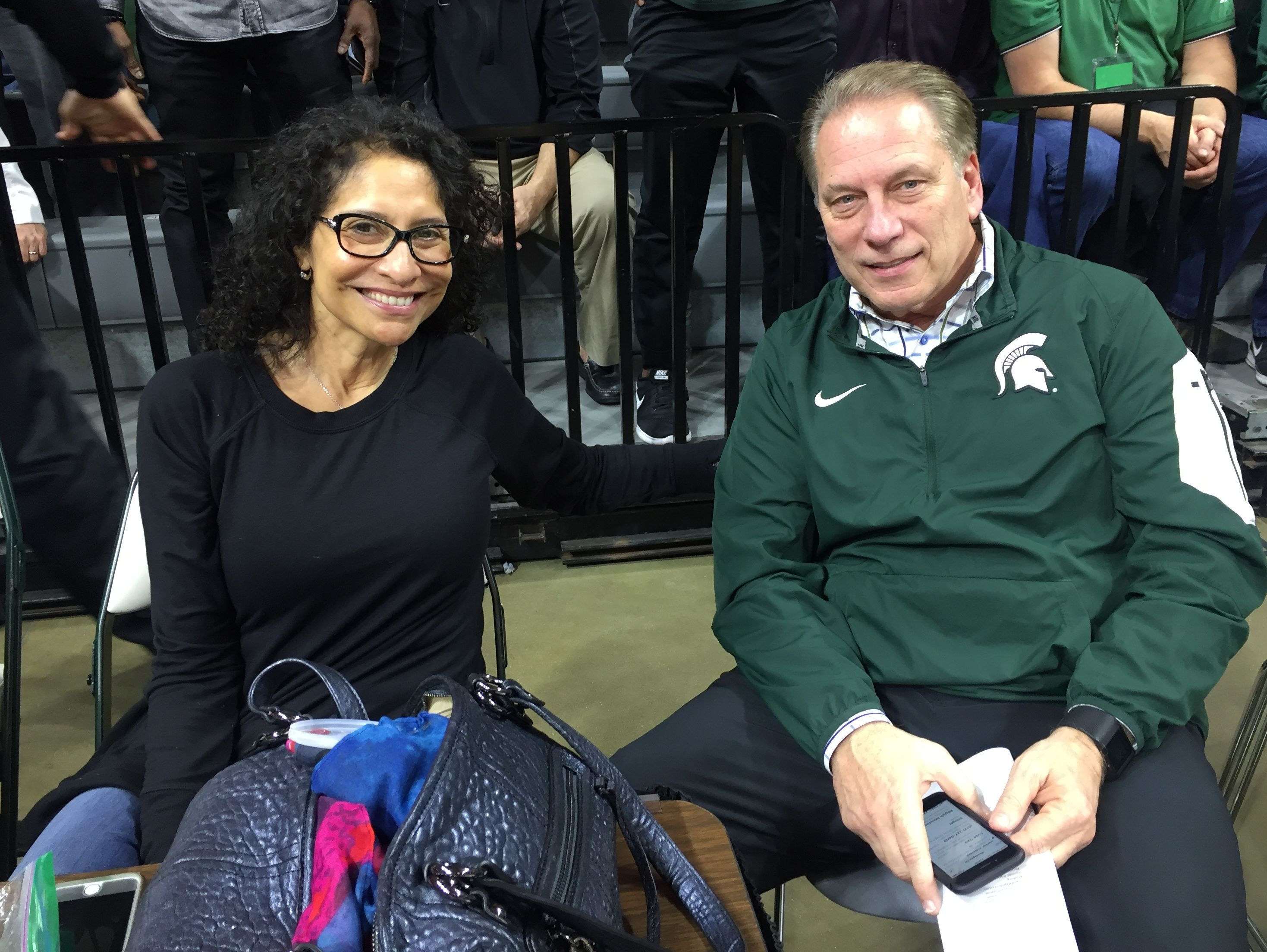 Michigan State basketball coach Tom Izzo and his wife, Lupe, sit courtside during the Class A boys basketball state semifinal win for Clarkston, led by MSU commit Foster Loyer on March 24.