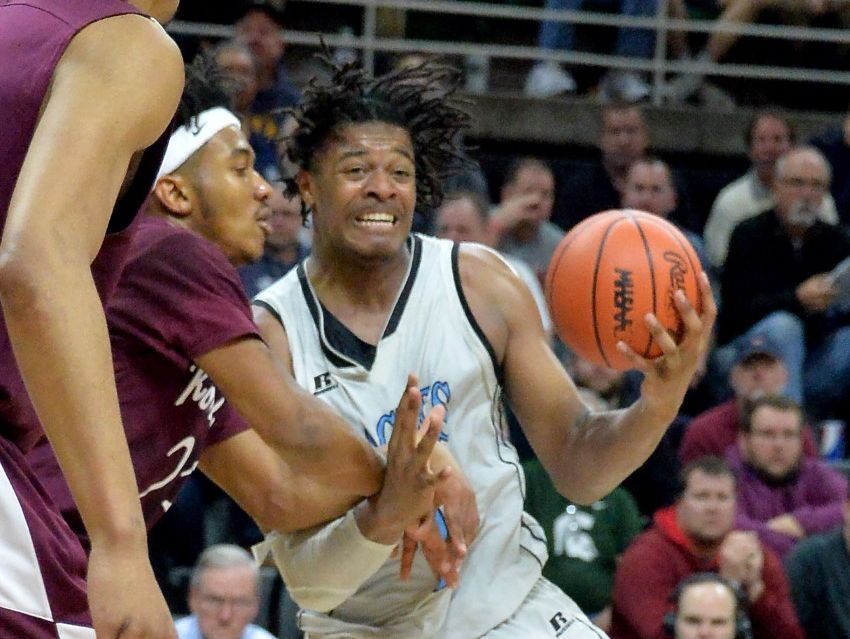 Grand Rapids Christian senior and Michigan State basketball commit Xavier Tillman helped the Eagles top Romulus in a Class A district semifinal showdown.