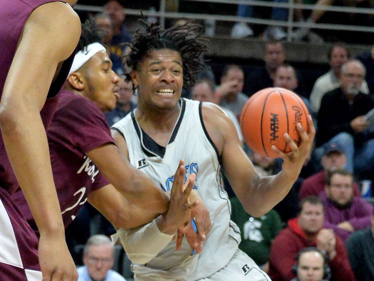 Grand Rapids Christian star forward and Michigan State signee Xavier Tillman drives to the basket against Romulus in a Class A semifinal on Friday, March 24, 2017 at the Breslin Center.