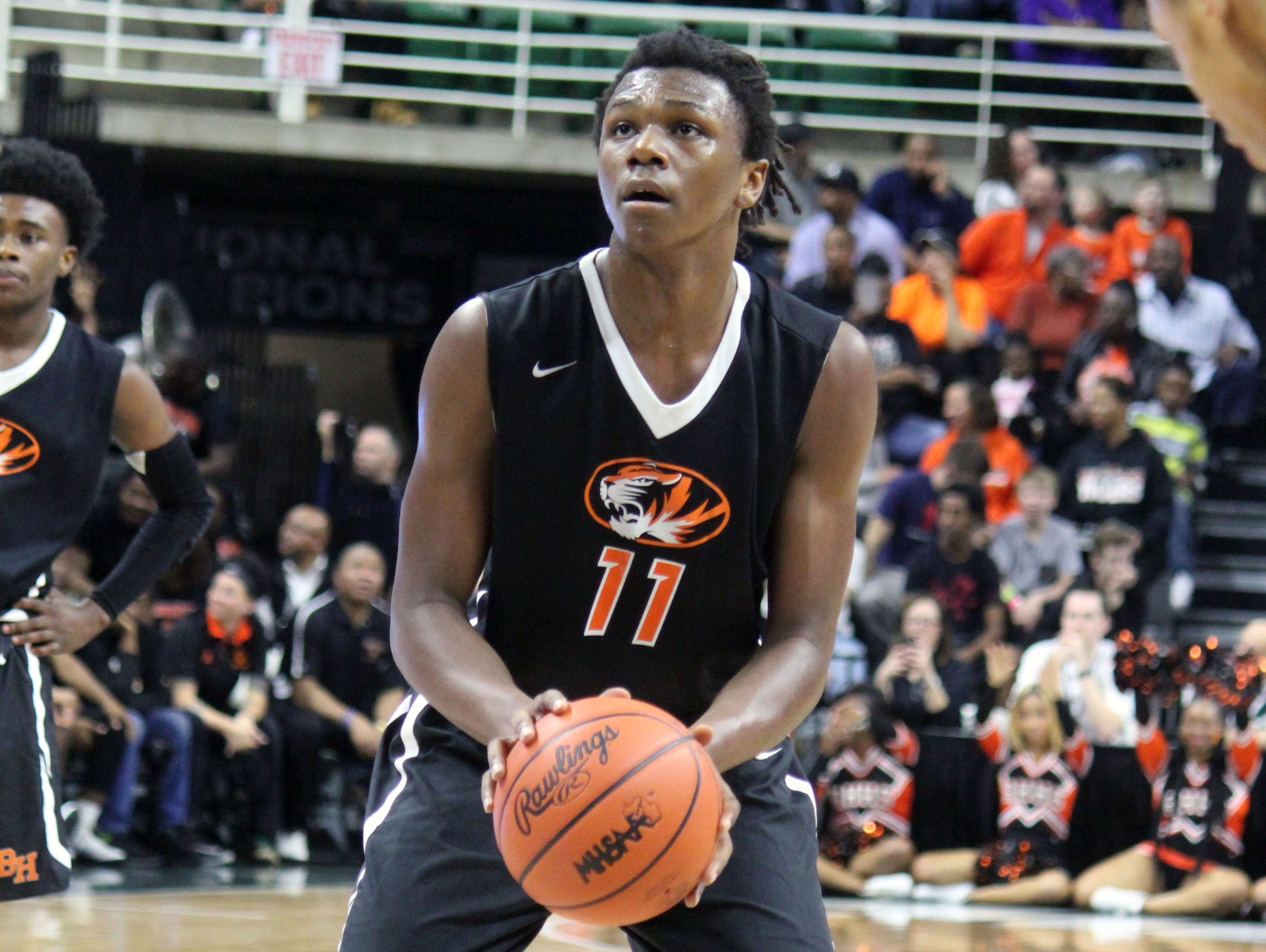 Benton Harbor center Carlos Johnson shoots a free throw during the loss in the Class B state semifinal to New Haven Friday in East Lansing.