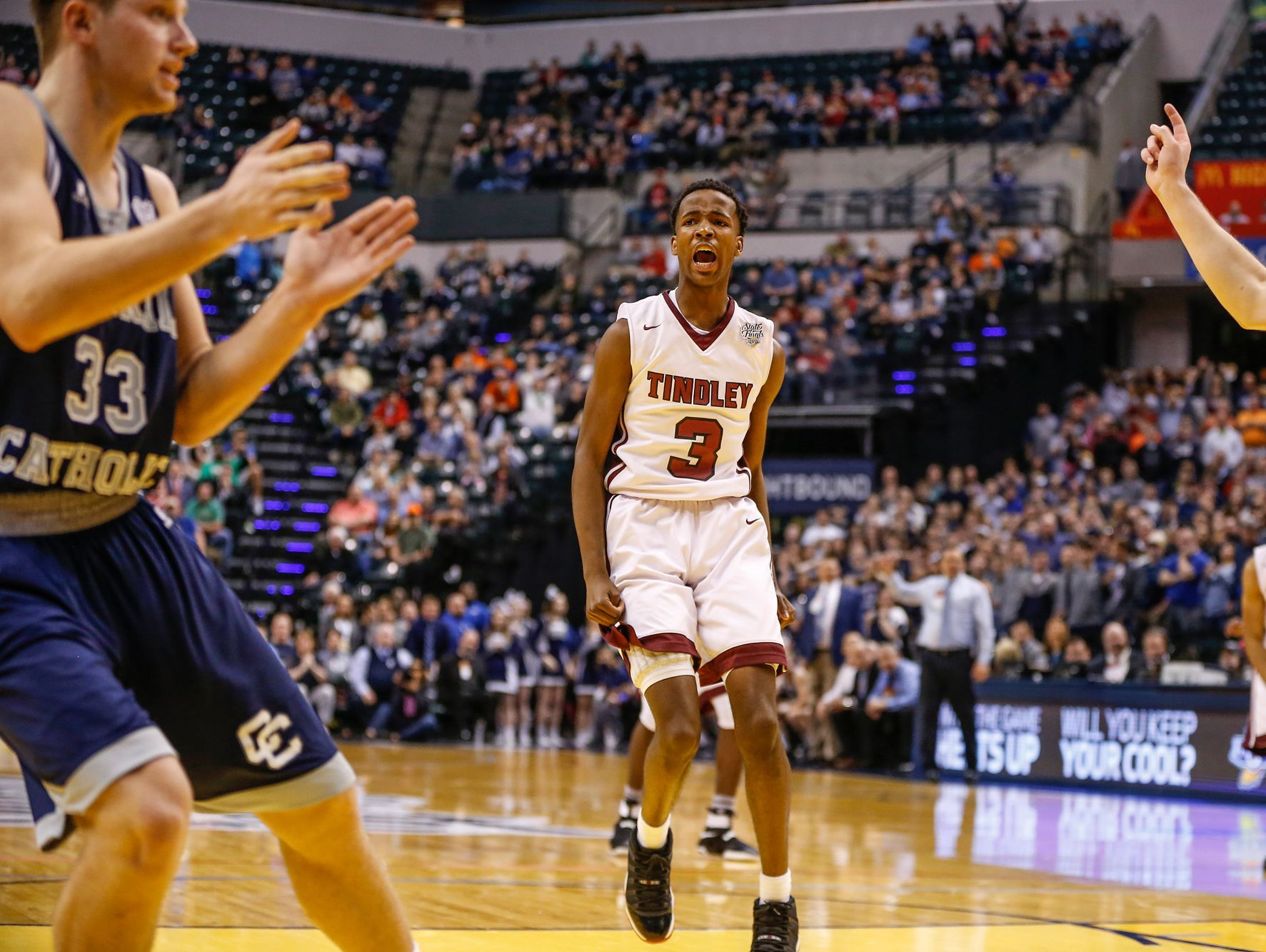 Tindley Tigers' Hunter White (3) celebrates after putting the Tigers up 51-49 over the Lafayette Central Catholic Knights as the time ticked off the clock in the fourth quarter during the IHSAA Class A state championship game at Bankers Life Fieldhouse in Indianapolis on Saturday, March 25, 2017.